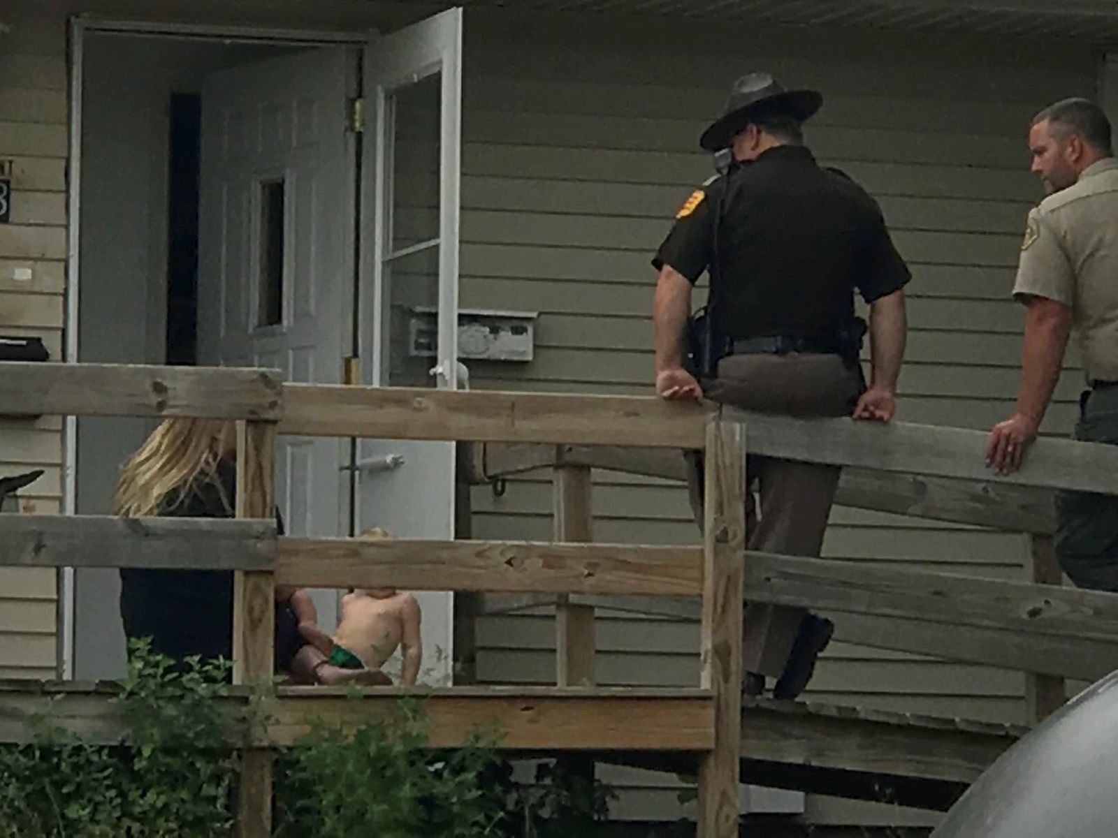 Ottumwa officers and troopers with the Iowa State Patrol search a residence at the intersection of Pennsylvania Avenue and Elm Street Thursday morning/KTVO