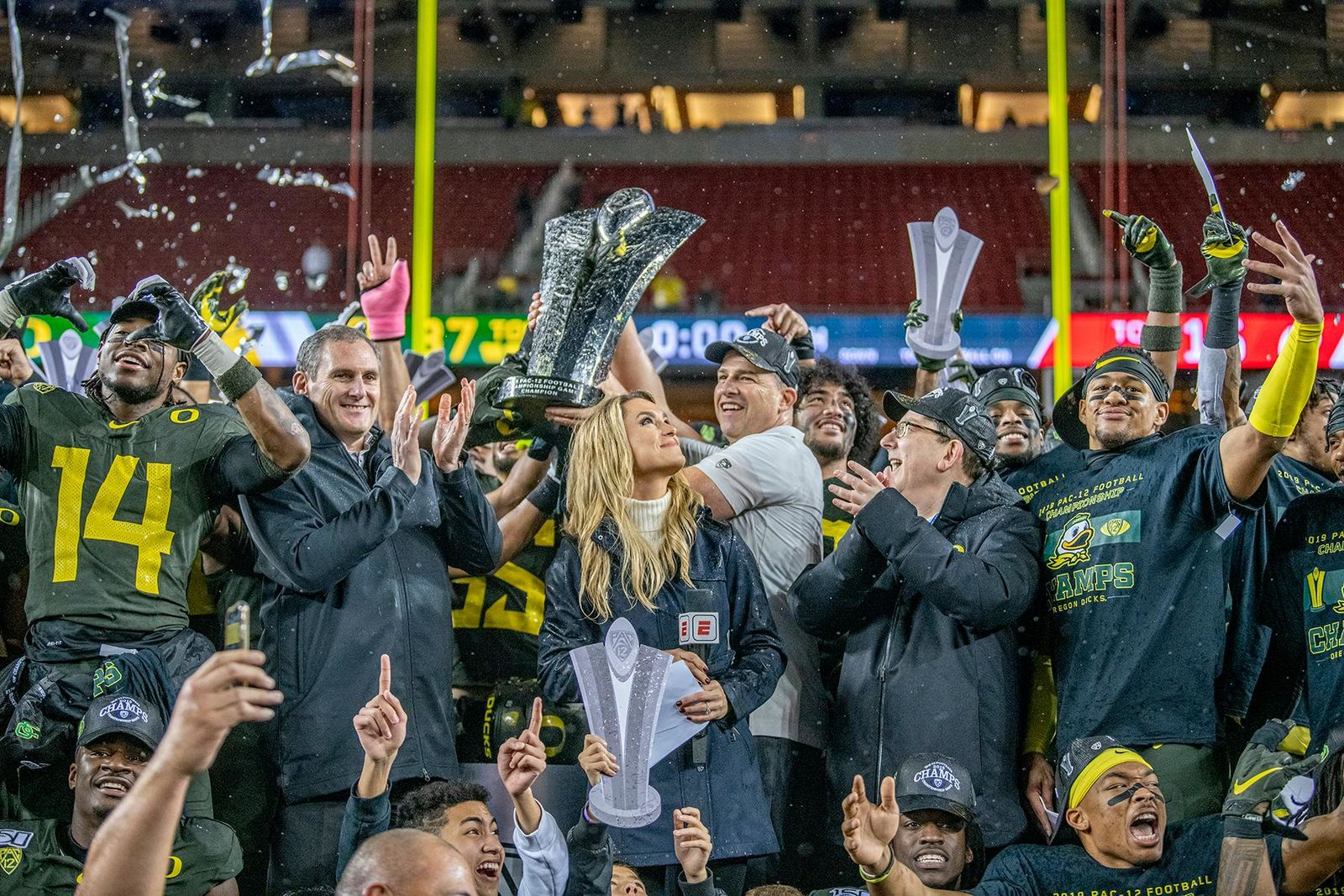Oregon's head coach Mario Cristoball hoisting up the PAC-12 championship after an impressive victory.  The University of Oregon Ducks defeated the University of Utah Utes 37-15 for the Pac 12 Championship Friday night at Levi's Stadium. Oregon's running back CJ Verdell, #7, rushed for 203 all-purpose yard along with three touchdowns for the night. Verdell was named the games M-V-P for his performace. Oregon's safey Brady Breeze, #25, contributed 9 tackles and one interception. Oregon's defensive end Kayvon Thibodeaux, #5, sacked Utah's quarterback Tyler Huntly, #1, for a total of three times. Oregon's quarterback Justin Herbert, #10, passed for 193 yards with one touchdown. The Oregon Ducks will represent the Pac 12 for the upcoming Rose Bowl game in the new year. Photo by Jeffrey Price