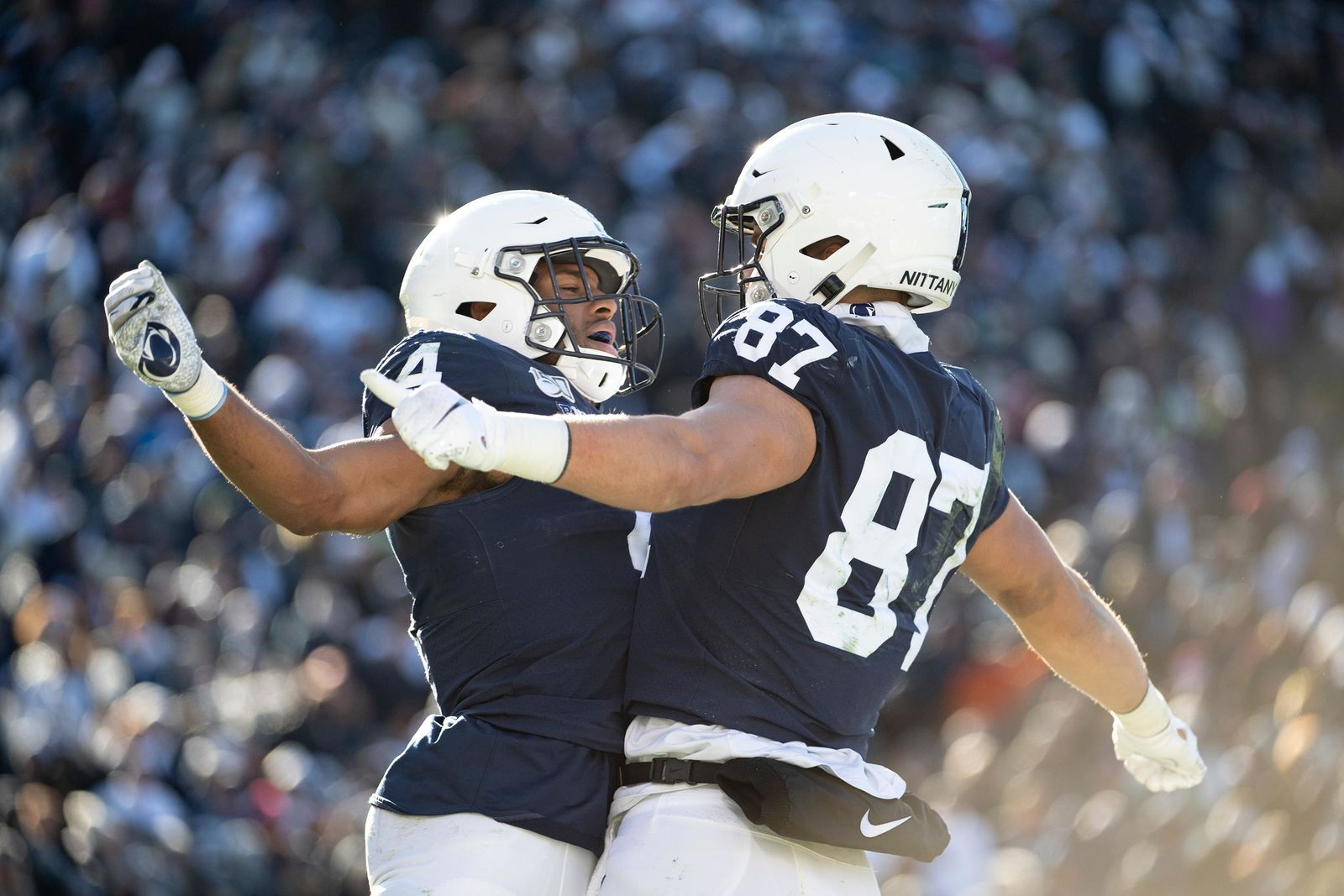 Penn State running back Journey Brown (4) celebrates with tight end Pat Freiermuth (87) after scoring on a 35-yard touchdown in the third quarter of an NCAA college football game against Indiana in State College, Pa., on Saturday, Nov.16, 2019. Penn State defeated 34-27. (AP Photo/Barry Reeger)
