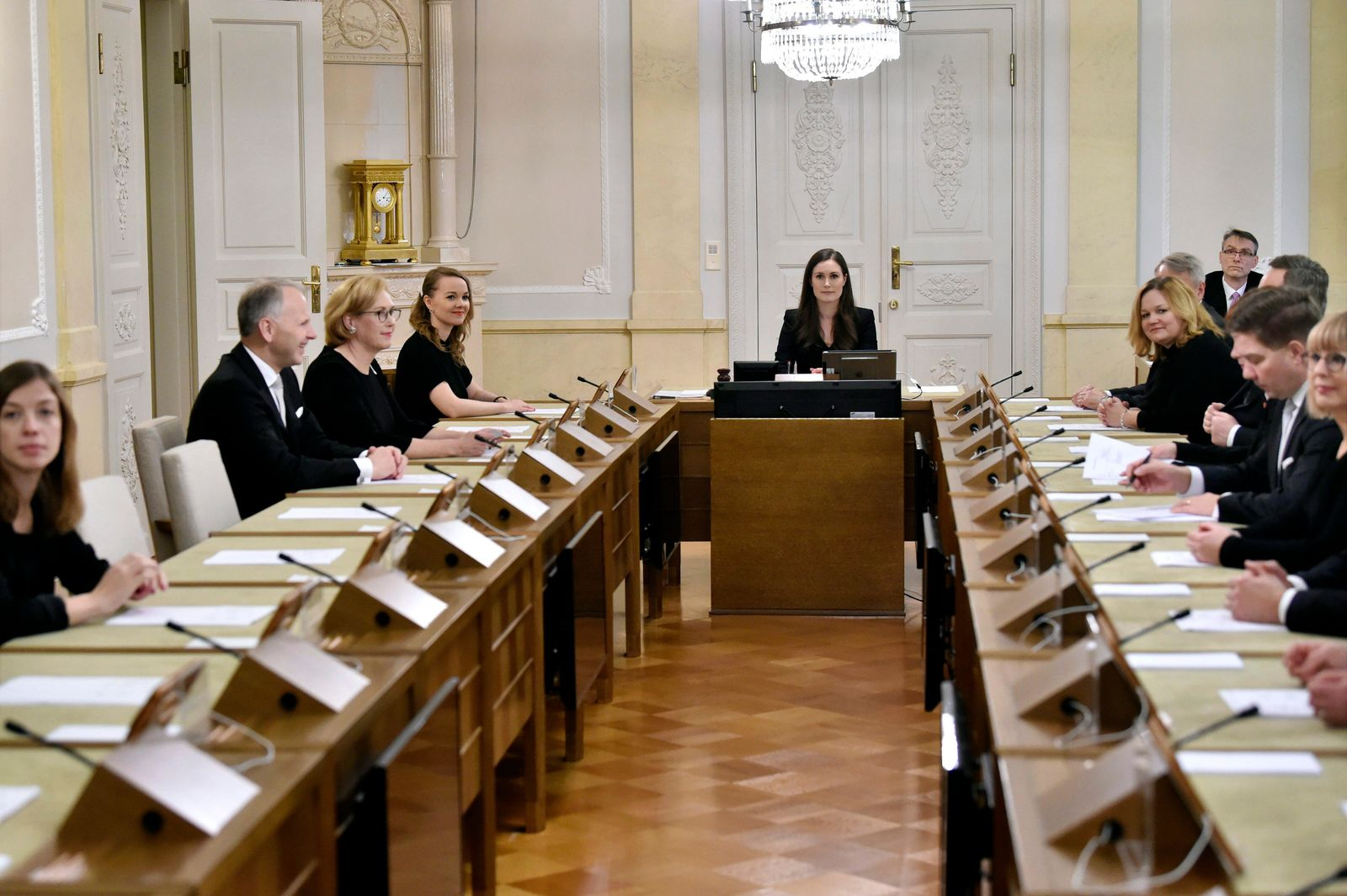 Prime Minister of Finland Sanna Marin, center, chairs her first government meeting in Helsinki, Finland on Tuesday Dec. 10, 2019. Finland's parliament chose Sanna Marin as the country's new prime minister Tuesday, making the 34-year-old the world's youngest sitting head of government. (Jussi Nukari/Lehtikuva via AP)