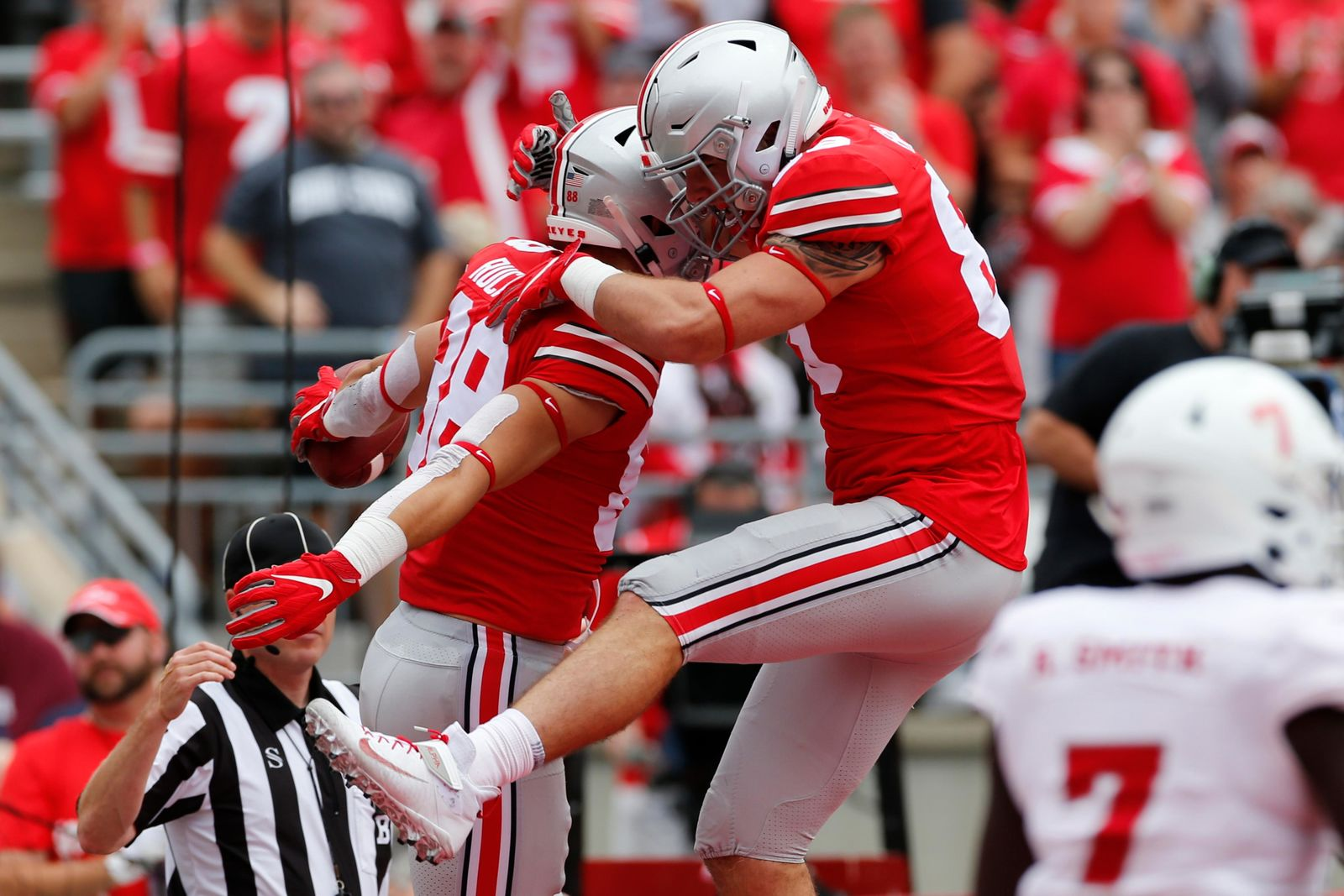 Ohio State tight end Jeremy Ruckert, left, celebrates his touchdown against Florida Atlantic with teammate tight end Luke Farrell during the first half of an NCAA college football game Saturday, Aug. 31, 2019, in Columbus, Ohio. (AP Photo/Jay LaPrete)