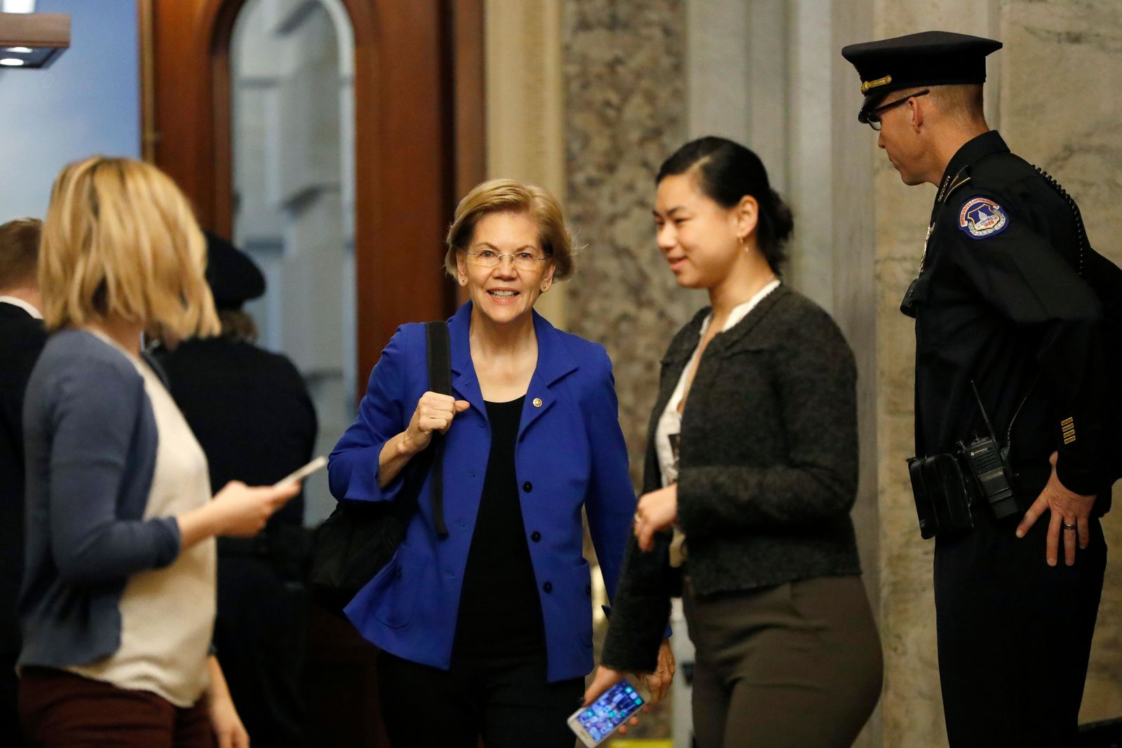 Sen. Elizabeth Warren, D-Mass., center, arrives at the Capitol in Washington during the impeachment trial of President Donald Trump on charges of abuse of power and obstruction of Congress, Saturday, Jan. 25, 2020. (AP Photo/Julio Cortez)