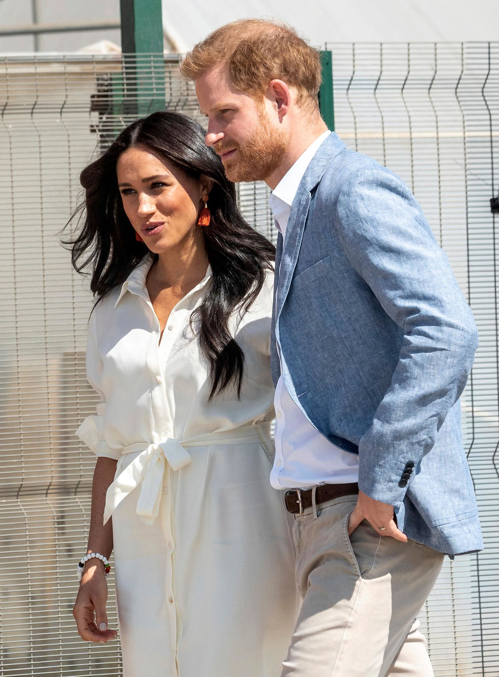 Britain's Prince Harry and Meghan, Duchess of Sussex visit a Youth Employment Services Hub in Makhulong, Tembisa, a township near Johannesburg, South Africa, Wednesday, Oct. 2, 2019. (AP Photo/Christiaan Kotze)