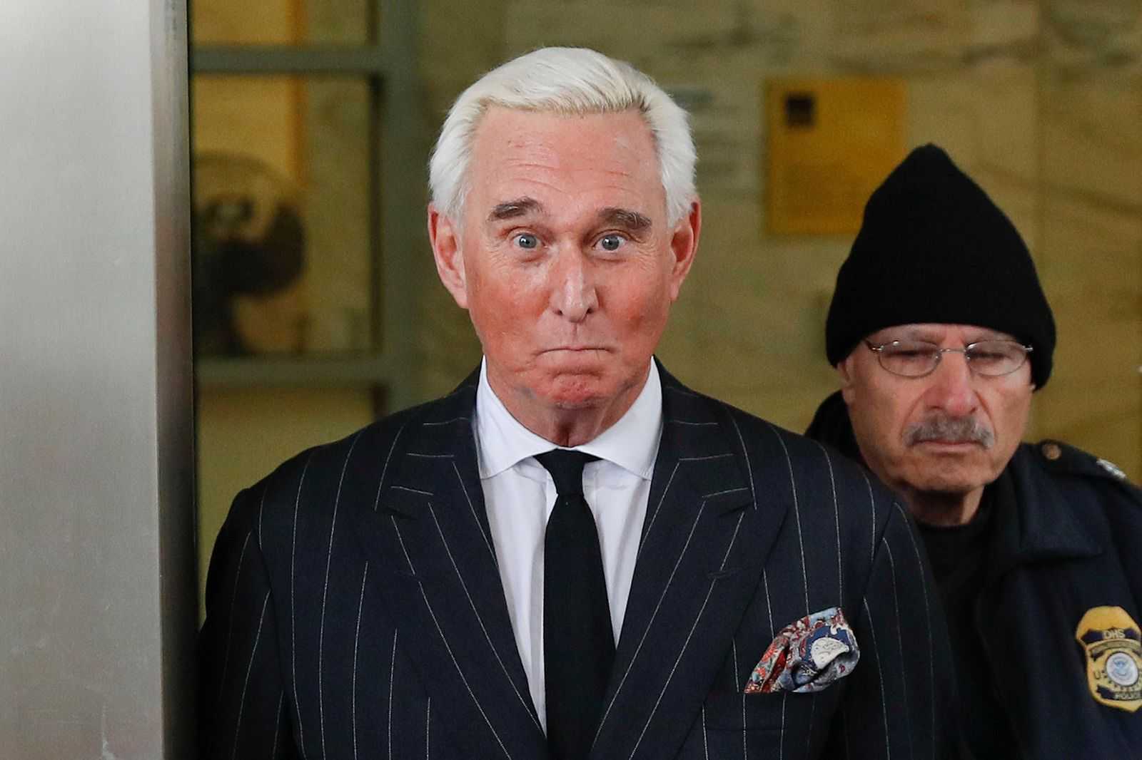 FILE - In this Feb. 1, 2019 file photo, former campaign adviser for President Donald Trump, Roger Stone, leaves federal court in Washington.{ } (AP Photo/Pablo Martinez Monsivais)