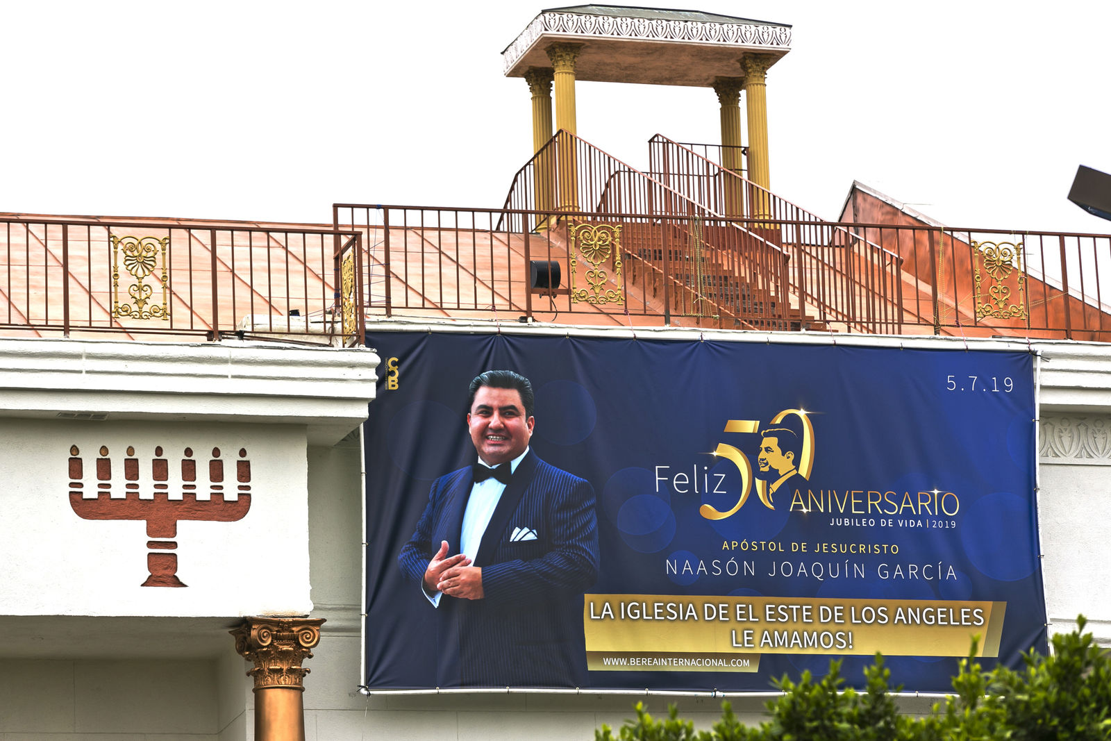 Mexico-based megachurch La Luz del Mundo, leader and self-proclaimed apostle Naasón Joaquín García's 50 birthday celebration portrait, is displayed on the side of the East Los Angeles temple on Friday, June 7, 2019. (AP Photo/Damian Dovarganes)