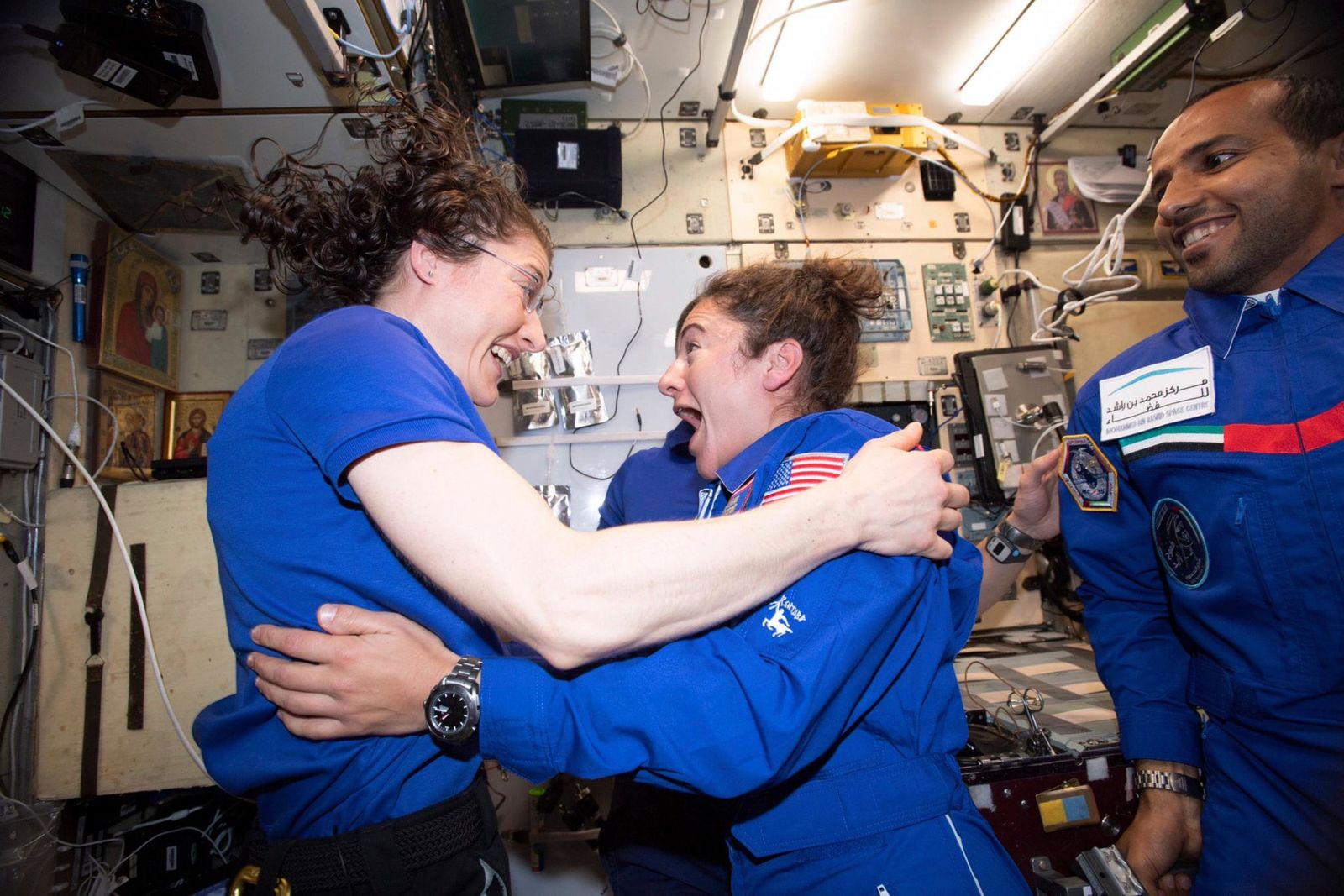 In this photo made available by NASA astronaut Jessica Meir on Sept. 29, 2019, Christina H. Koch, left, and Meir greet each other after Meir's arrival on the International Space Station. (NASA via AP)