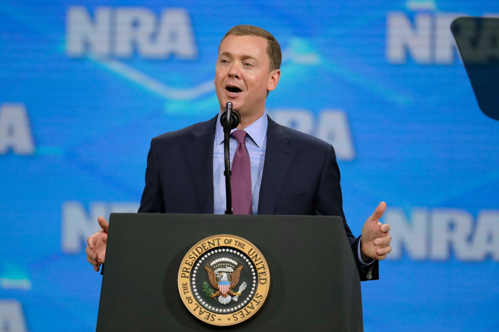 FILE- In this April 26, 2019 file photo, Nation Rifle Association Institute for Legislative Action Executive Director Christopher W. Cox speaks at the NRA-ILA Leadership Forum in Lucas Oil Stadium in Indianapolis. (AP Photo/Michael Conroy, File)