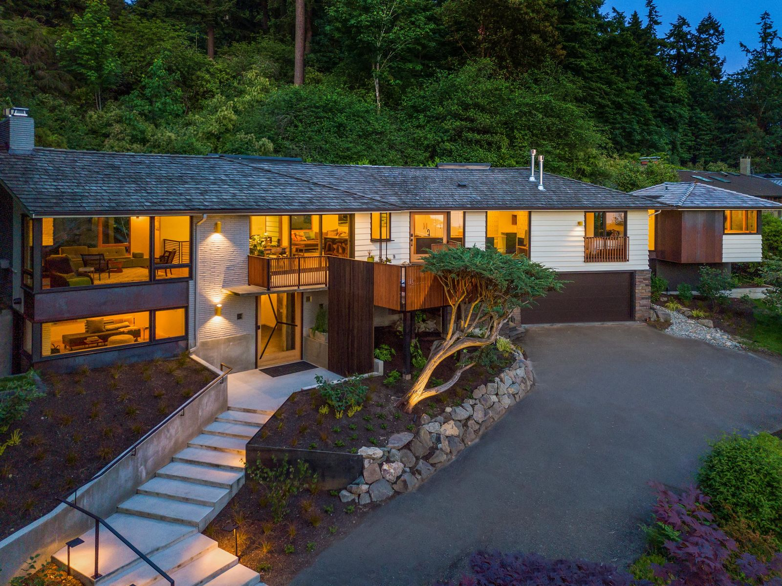 "The designer pulled out all of the stops in this ""complete reinvention of a classic mid-century home.""<a  href=""https://www.windermere.com/listing/WA/Seattle/1031-NW-Elford-Dr-98177/96196208"" target=""_blank"" title=""https://www.windermere.com/listing/WA/Seattle/1031-NW-Elford-Dr-98177/96196208"">{&nbsp;}Listed by Windermere,{&nbsp;}</a>this home is described as nuanced, custom, elegant and luxe with playful details. Sitting on nearly 2/3 acre, the home boasts western views of the water and mountains and ""feels as if you've escaped to the islands"" yet is still only 10 miles to downtown or South Lake Union! With 4 beds, 5 baths and 3,893 square feet, the home is listed at $2,798,000. (Image courtesy of Windermere)."