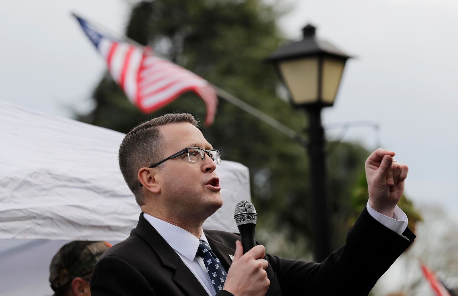 "FILE - In this Jan. 18, 2019, file photo, Rep. Matt Shea, R-Spokane Valley, speaks at a gun-rights rally at the Capitol in Olympia, Wash. Recently published internet chats from 2017 show Shea and three other men discussing confronting ""leftists"" with a variety of tactics, including violence, surveillance and intimidation. (AP Photo/Ted S. Warren, File)"