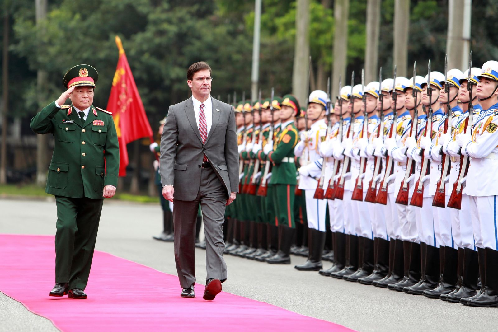 U.S. Defense Secretary Mark Esper, center, and Vietnamese Defense Minister Ngo Xuan Lich review an honor guard in Hanoi, Vietnam Wednesday, Nov. 20, 2019. (AP Photo/Hau Dinh)