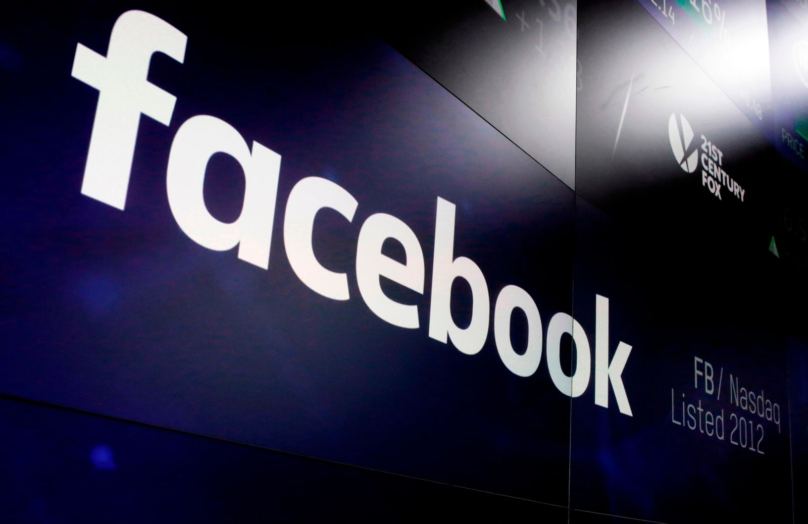 FILE- In this March 29, 2018, file photo, the logo for Facebook appears on screens at the Nasdaq MarketSite in New York's Times Square.{ } (AP Photo/Richard Drew, File)