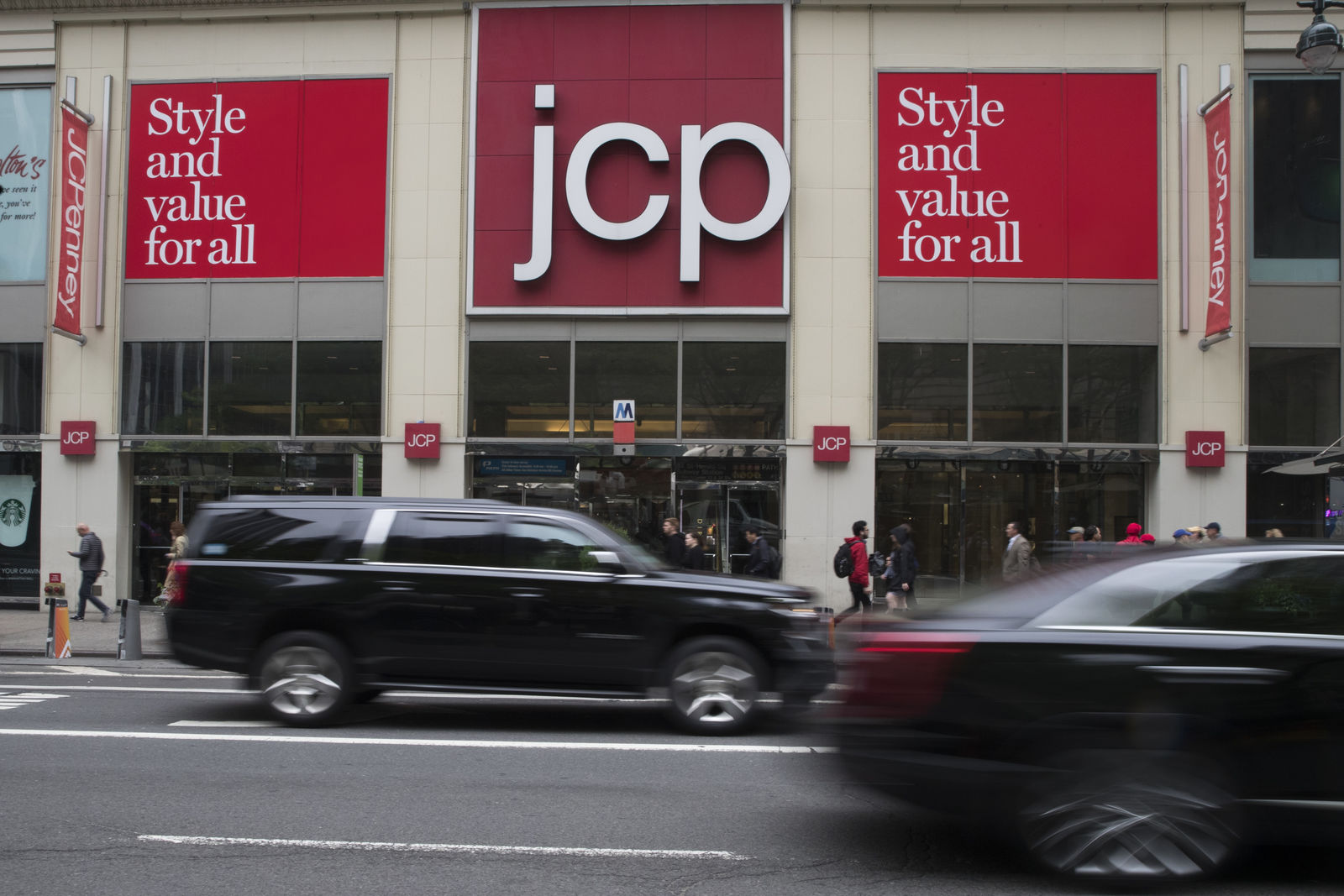 FILE - In this May 16, 2018, file photo, traffic makes its way past a logo J.C. Penney store outside the Manhattan mall in New York. J.C. Penney Co. reports financial results Thursday, Aug. 15..(AP Photo/Mary Altaffer, File)