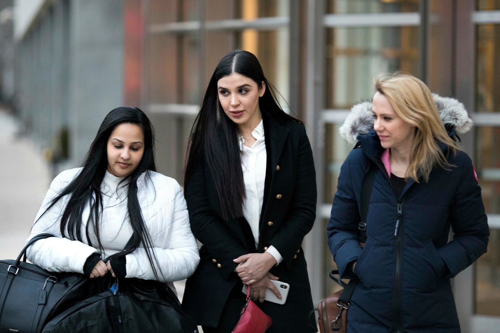 "Emma Coronel Aispuro, center, leaves Brooklyn federal court, Thursday, Jan. 17, 2019 in New York, after attending the trial of her husband Joaquin ""El Chapo"" Guzman. (AP Photo/Kevin Hagen)"