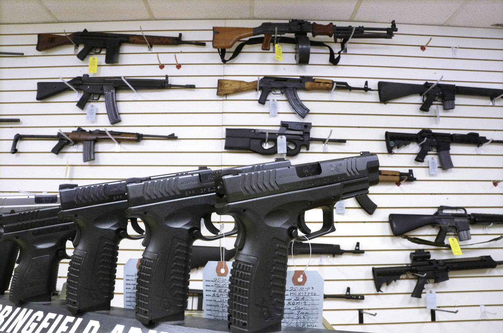 FILE--In this Jan. 16, 2013, file photo, assault weapons and hand guns are seen for sale at Capitol City Arms Supply in Springfield, Ill. (AP Photo/Seth Perlman, file)
