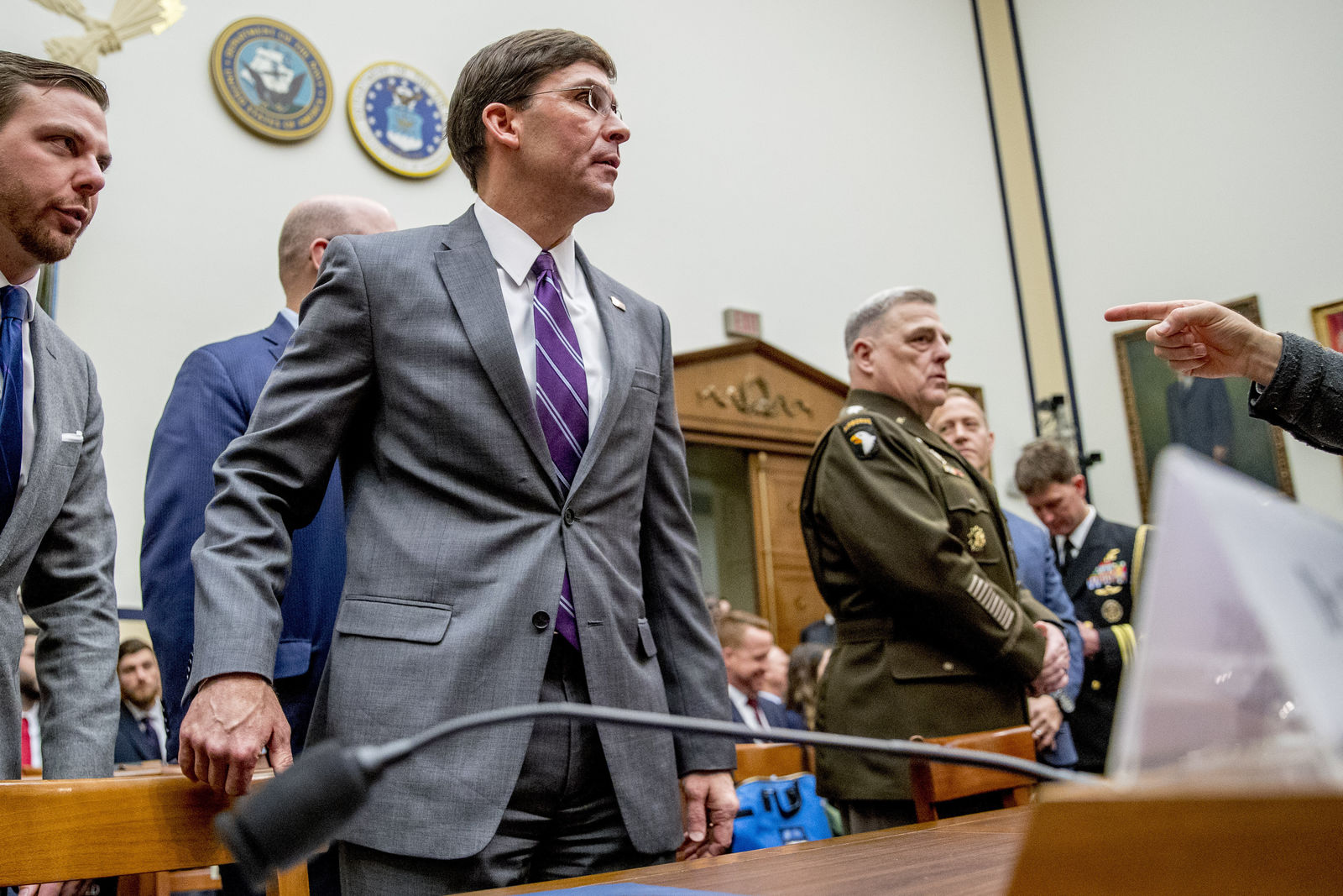 Defense Secretary Mark Esper, left, and Joint Chiefs of Staff Chairman Gen. Mark Milley, right, arrive for a House Armed Services Committee hearing on Capitol Hill, Wednesday, Feb. 26, 2020, in Washington. (AP Photo/Andrew Harnik)