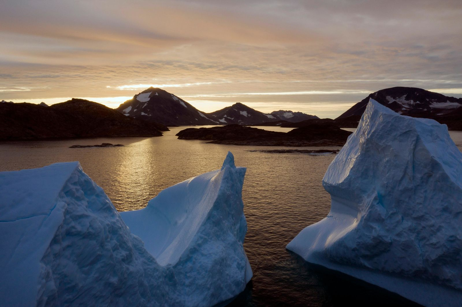 An aerial view of large Icebergs floating as the sun rises near Kulusuk, Greenland, early Friday, Aug. 16, 2019.{ } (AP Photo/Felipe Dana)