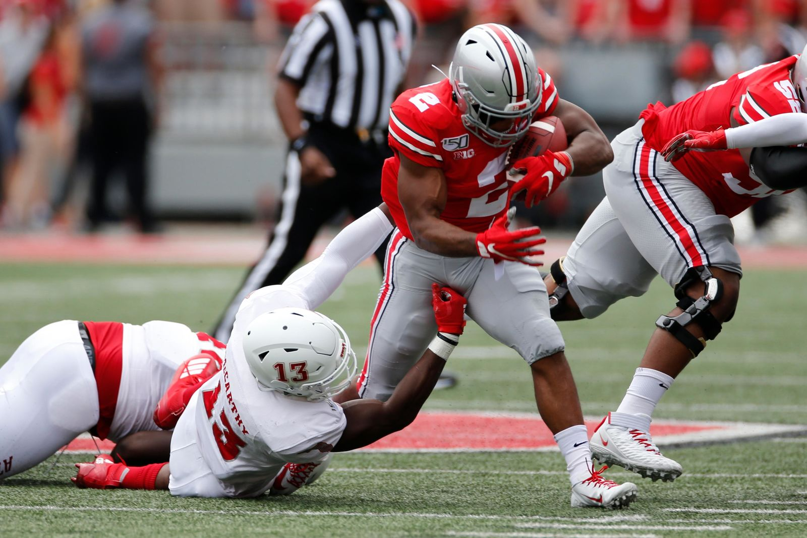Ohio State running back J.K. Dobbins is tackled by Florida Atlantic defensive lineman Leighton McCarthy during the first half of an NCAA college football game Saturday, Aug. 31, 2019, in Columbus, Ohio. (AP Photo/Jay LaPrete)