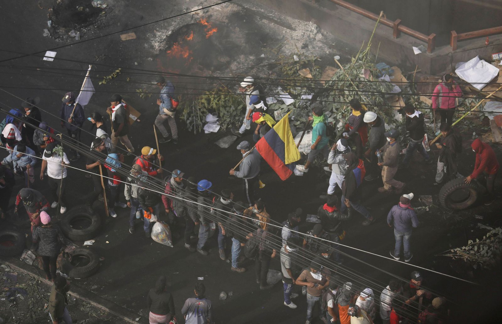 Anti-government demonstrators begin to vacate the area ahead of a 4pm curfew, in Quito, Ecuador, Saturday, Oct. 12, 2019.{ } (AP Photo/Fernando Vergara)