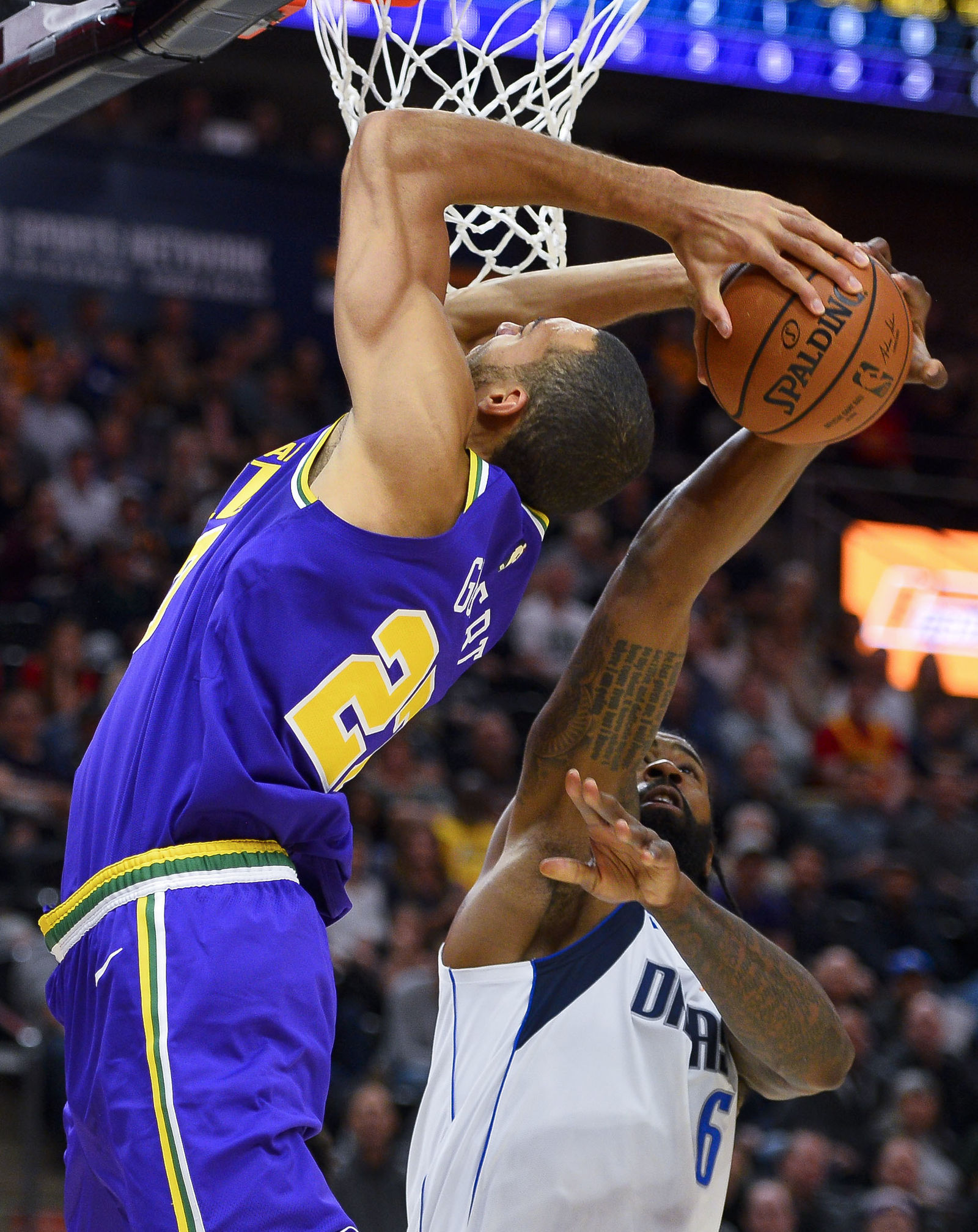 Utah Jazz center Rudy Gobert (27) tries to shoot as Dallas Mavericks center DeAndre Jordan (6) gets a hand on the ball during the first half of an NBA basketball game Wednesday, Nov. 7, 2018, in Salt Lake City. (AP Photo/Alex Goodlett)