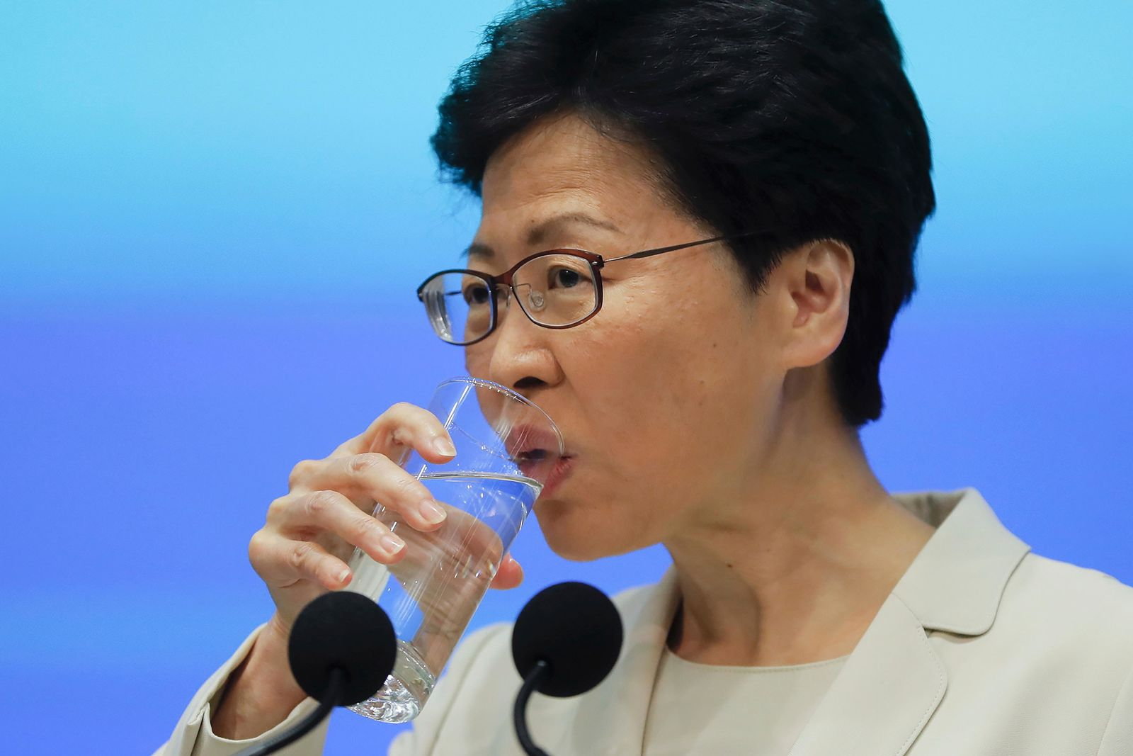 Hong Kong Chief Executive Carrie Lam drinks during a press conference at the Legislative Council in Hong Kong, Tuesday, June 18, 2019. Lam apologized Tuesday for an unpopular extradition bill that drew massive protests and indicated that it will not be revived during the current legislative session. (AP Photo/Kin Cheung)