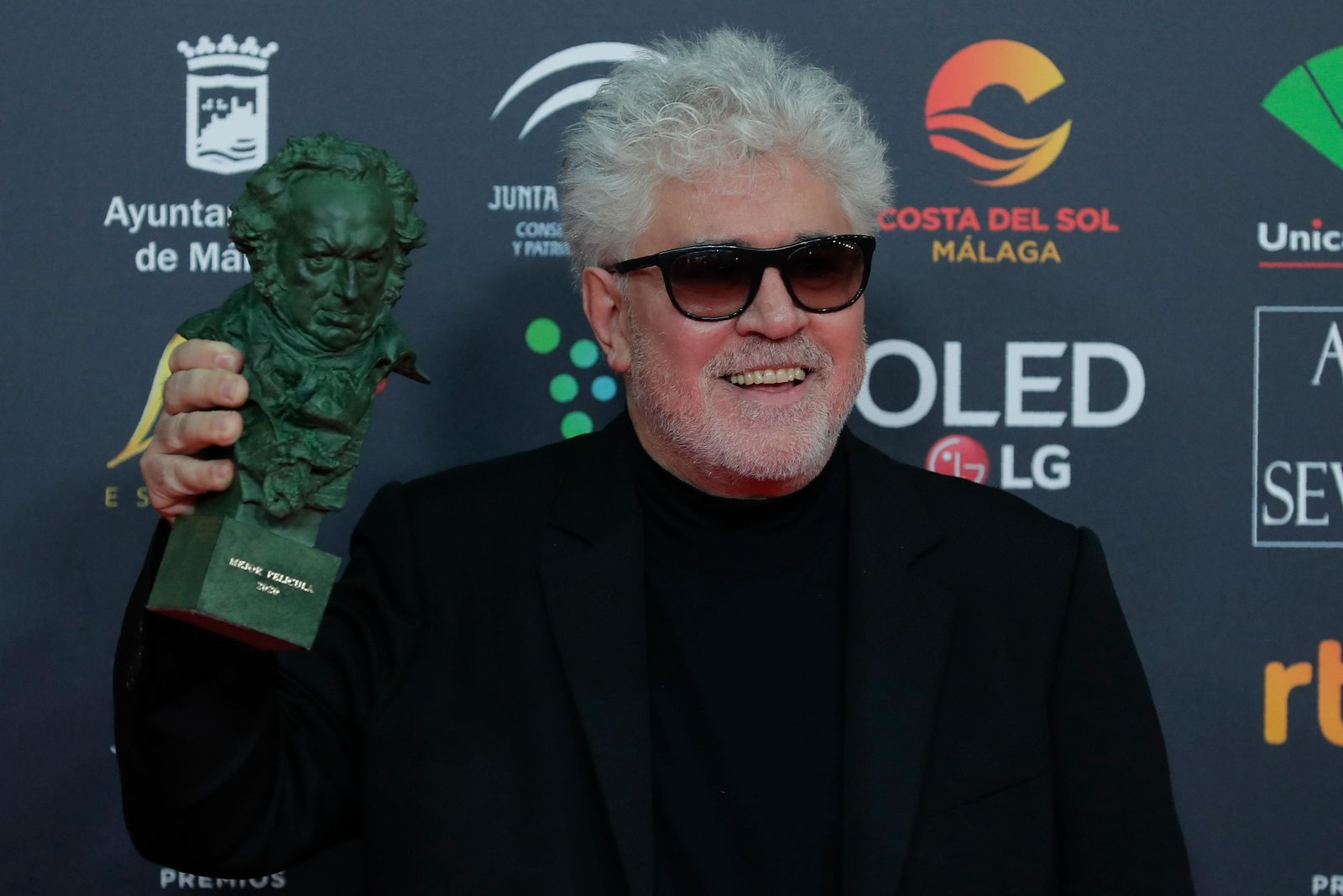 "Spanish film director Pedro Almodovar poses with his trophy after winning the best film award for ""Dolor y gloria"" during the Goya Film Awards Ceremony in Malaga, southern Spain, early Sunday, Jan. 26, 2020. The annual Goya Awards are Spain's main national film awards. (AP Photo/Manu Fernandez)"