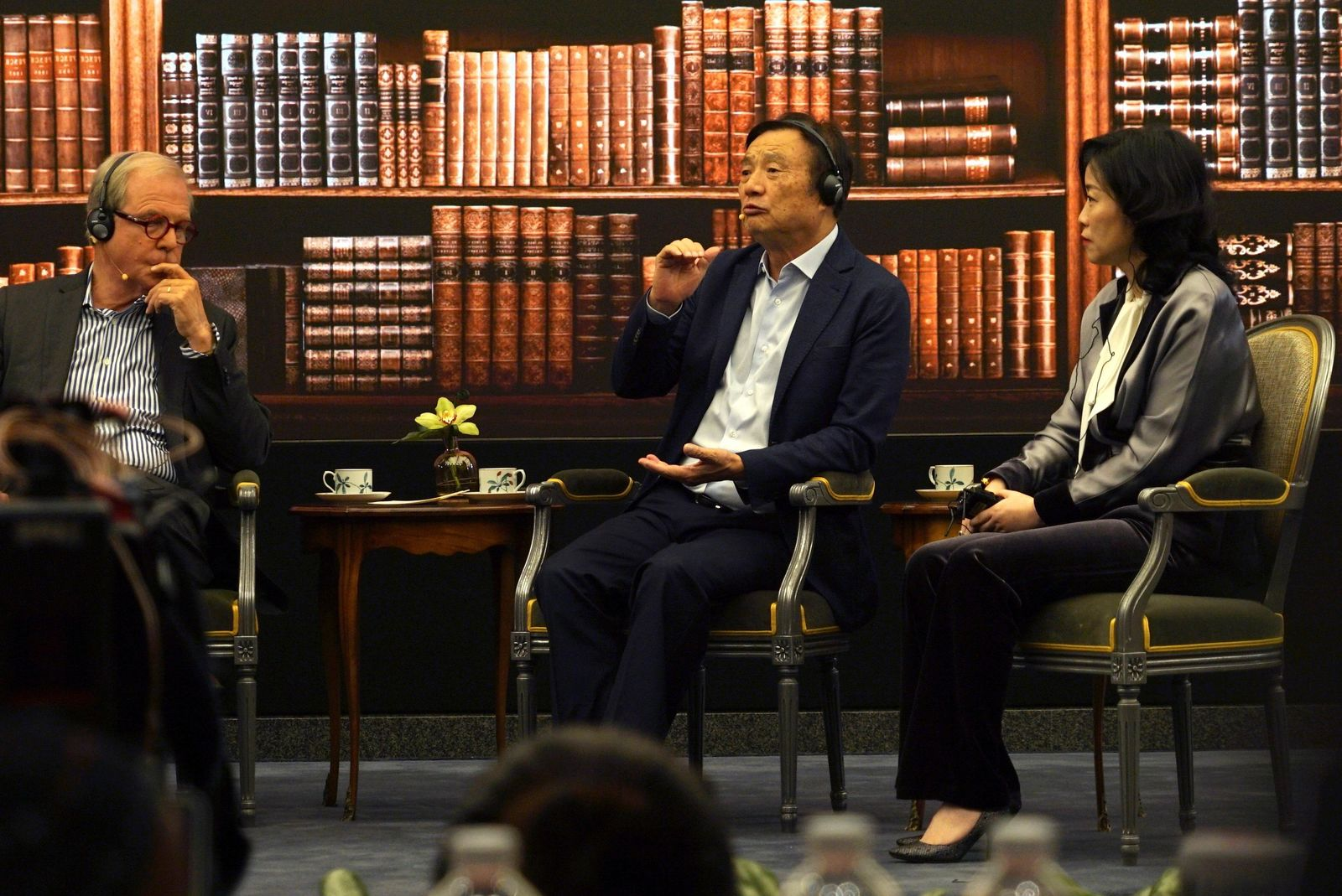 Huawei founder Ren Zhengfei, center, speaks at a roundtable at the telecom giant's headquarters in Shenzhen in southern China on Monday, June 17, 2019. . (AP Photo/Dake Kang)