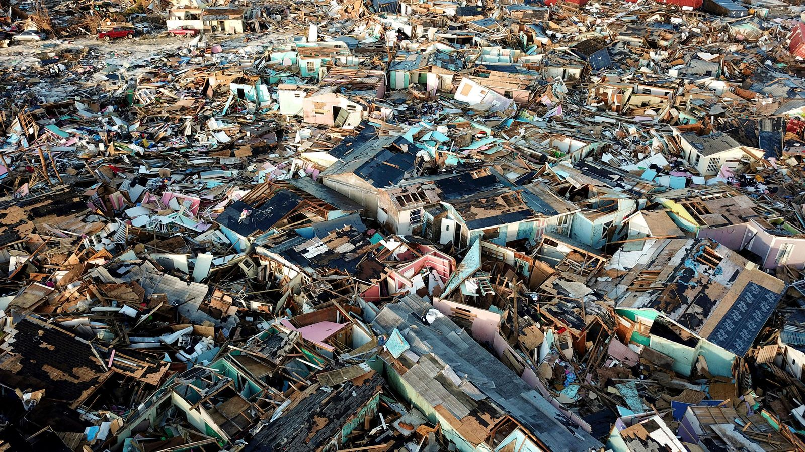 Homes lay in ruins one week after Hurricane Dorian hit The Mudd neighborhood, in the Marsh Harbor area of Abaco, Bahamas, Monday, Sept. 9, 2019. (AP Photo/Fernando Llano)