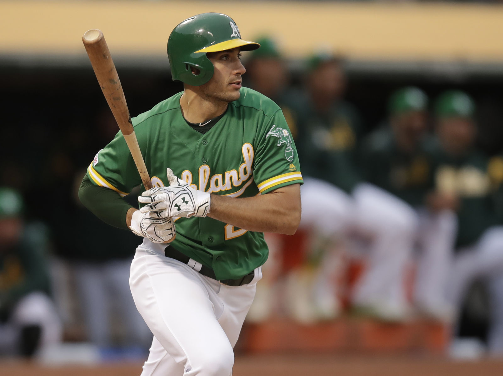 Oakland Athletics' Matt Olson follows through on an RBI-single off Seattle Mariners' Marco Gonzales in the third inning of a baseball game Friday, June 14, 2019, in Oakland, Calif. (AP Photo/Ben Margot)