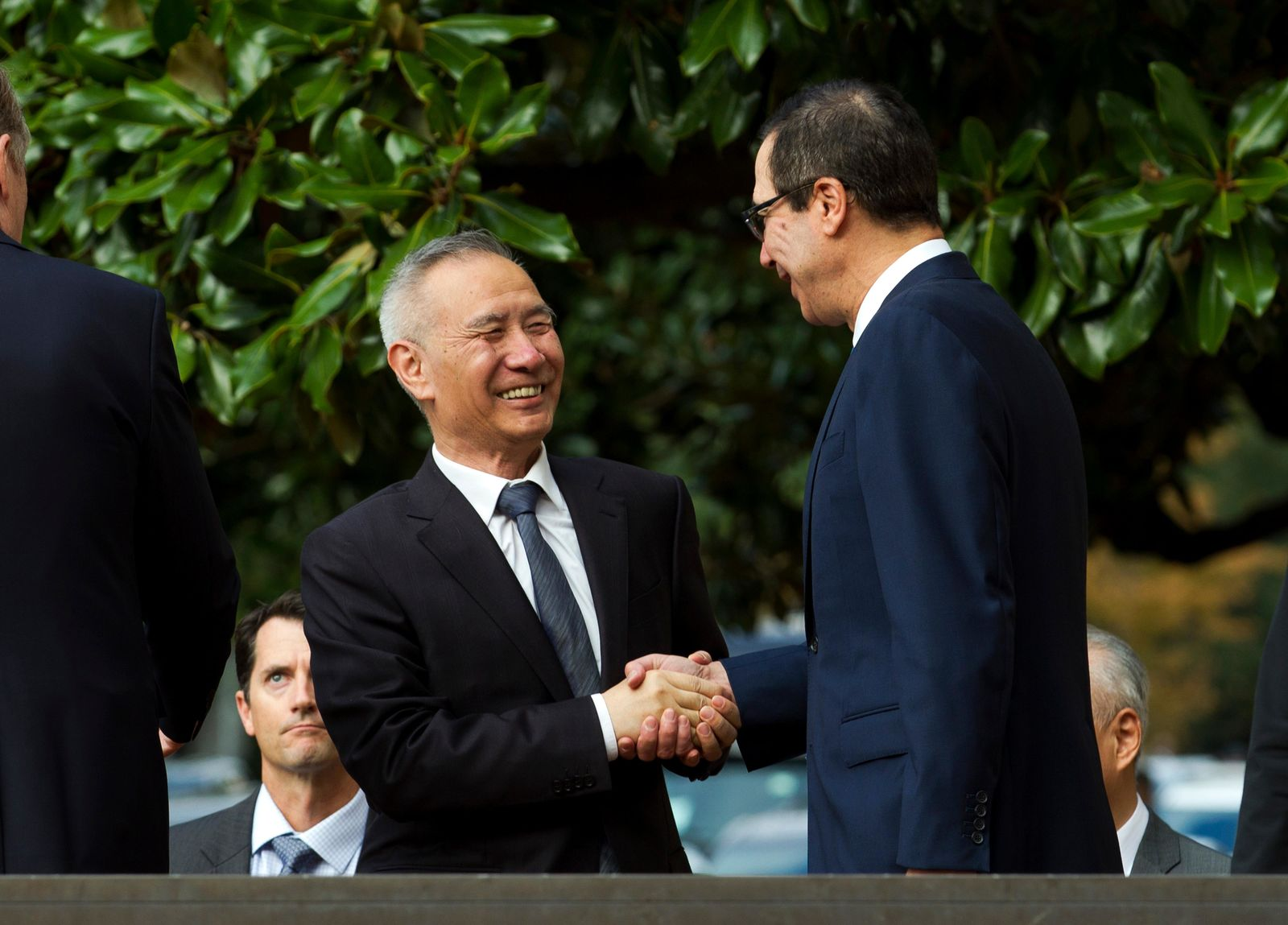 Chinese Vice Premier Liu He shake hands with Treasury Secretary Steven Mnuchin, as he arrives for a minister-level trade meeting in Washington, Thursday, Oct. 10, 2019. (AP Photo/Jose Luis Magana)