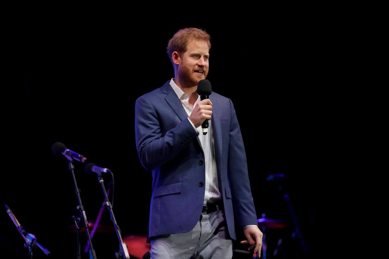 Britain's Prince Harry speaks on stage during a concert hosted by his charity Sentebale at Hampton Court Palace, in London, Tuesday June 11, 2019. (AP Photo/Matt Dunham, Pool)