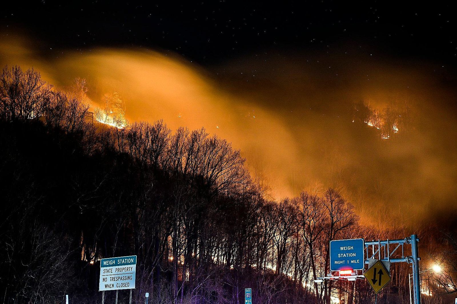 ADDS DATE - This photo provided by Adam Polinger shows a wildfire near the New Jersey side of the Delaware Water Gap National Recreation Area near Hardwick Township, N.J., Sunday, Feb. 23, 2020. (Adam Polinger via AP)