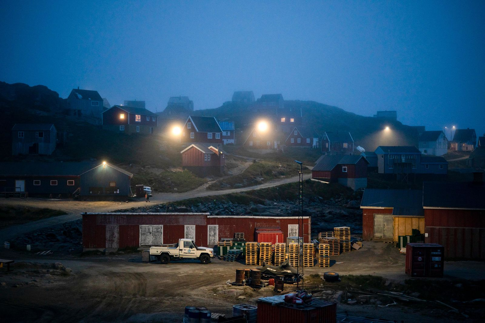 FILE - In this Aug. 15, 2019, file photo, early morning fog shrouds homes in Kulusuk, Greenland.{ } (AP Photo/Felipe Dana, File)