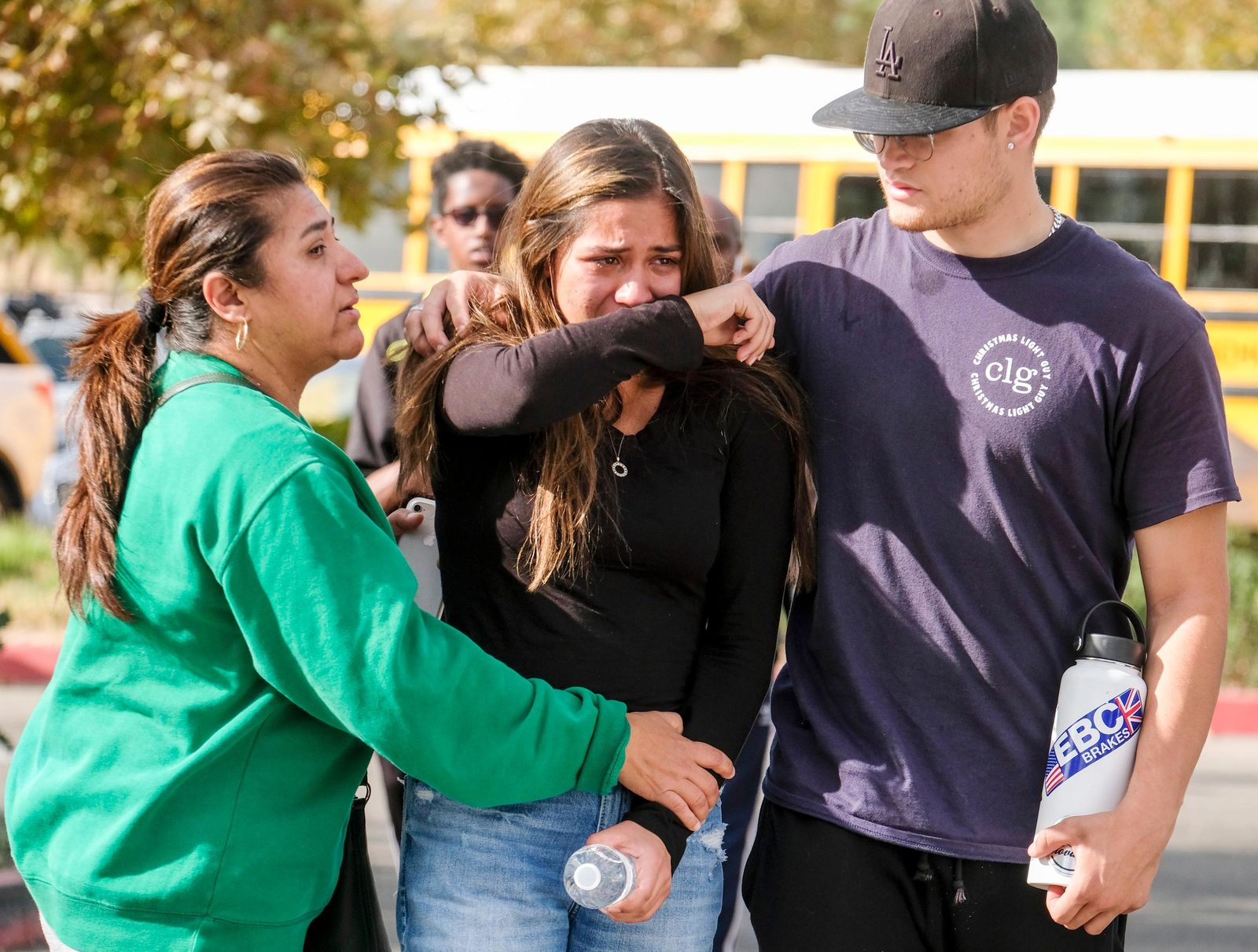 A student is comforted as she reunite at a park following a shooting at Saugus High School that injured several people, Thursday, Nov. 14, 2019, in Santa Clarita, Calif. (AP Photo/Ringo H.W. Chiu)
