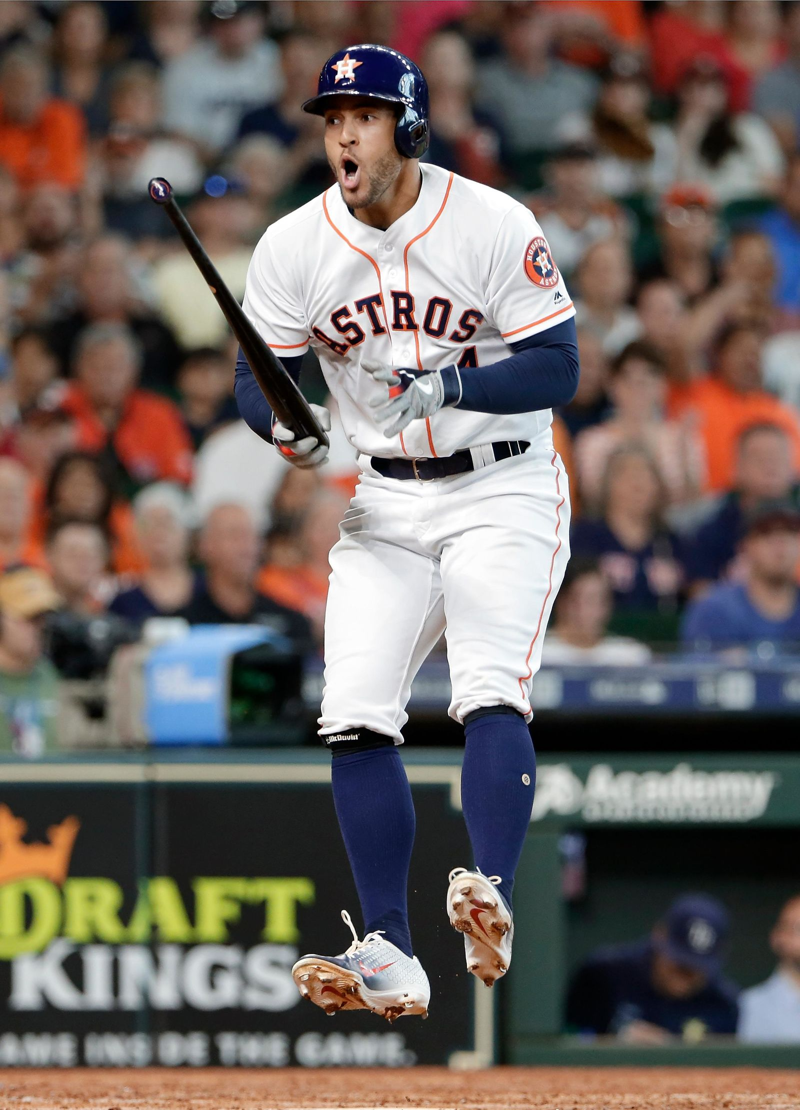 With the bases loaded, Houston Astros' George Springer jumps in the air in reaction to getting a strike call on what he thought was a ball during the fourth inning of a baseball game against Tampa Bay Thursday, Aug. 29, 2019, in Houston. Springer was walked on the next pitch, scoring a run.(AP Photo/Michael Wyke)