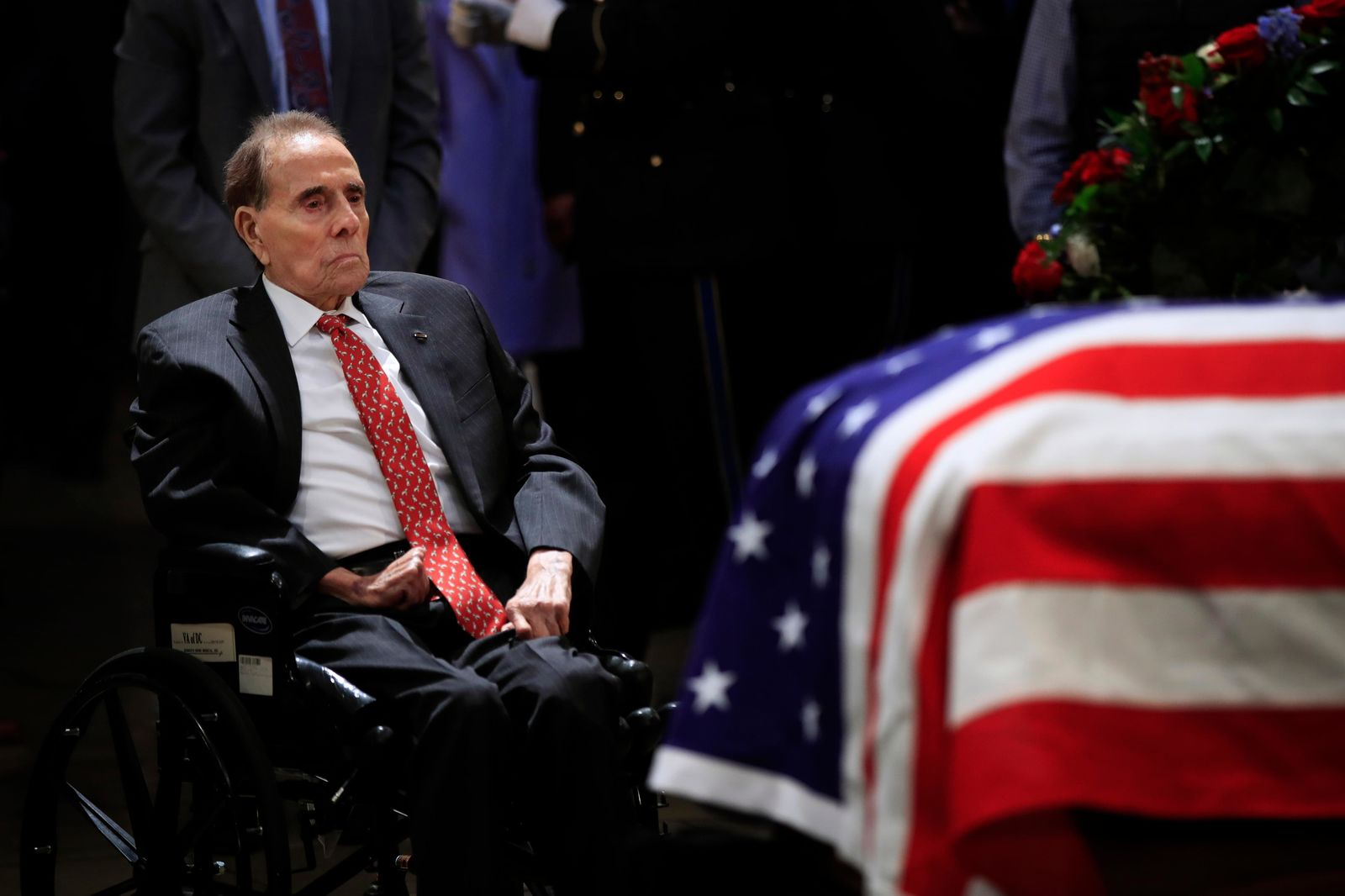 Former Sen. Bob Dole pays his last respects to former President George H.W. Bush as he lies in state at the U.S. Capitol in Washington, Tuesday, Dec. 4, 2018. (AP Photo/Manuel Balce Ceneta)