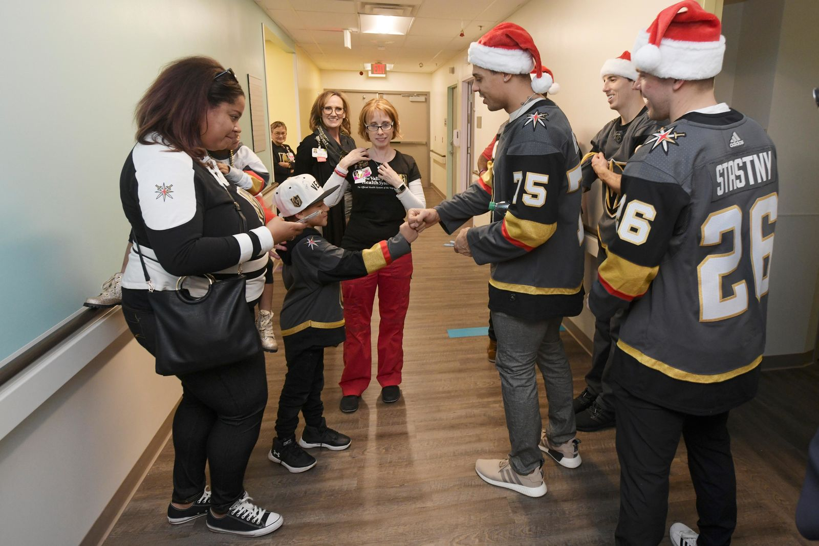 Aiden Woodward gets a fist bump from his favorite player, Ryan Reaves, as the Vegas Golden Knights pay a visit to Summerlin Hospital Friday, December 21, 2018. CREDIT: Sam Morris/Las Vegas News Bureau