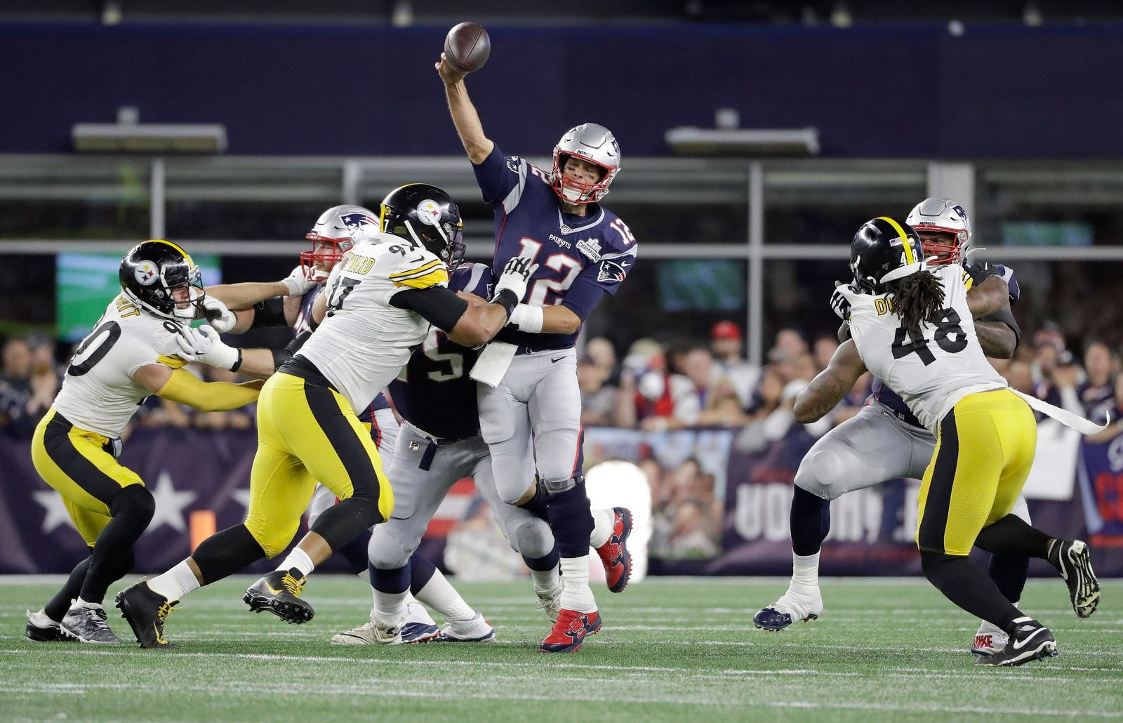 New England Patriots quarterback Tom Brady passes under pressure from Pittsburgh Steelers defenders T.J. Watt (90), Cameron Heyward (97) and Bud Dupree (48) in the first half an NFL football game, Sunday, Sept. 8, 2019, in Foxborough, Mass. (AP Photo/Steven Senne)