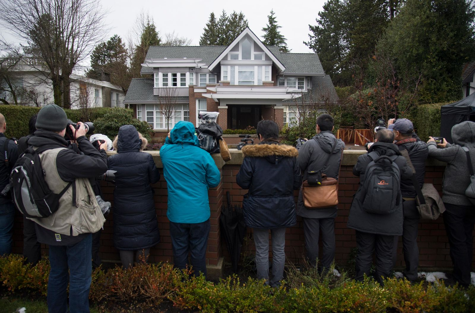 Media wait for Meng Wanzhou, chief financial officer of Huawei, to leave her home to attend a hearing in Vancouver, Monday, January, 20, 2020. (THE CANADIAN PRESS/Jonathan Hayward/The Canadian Press via AP)