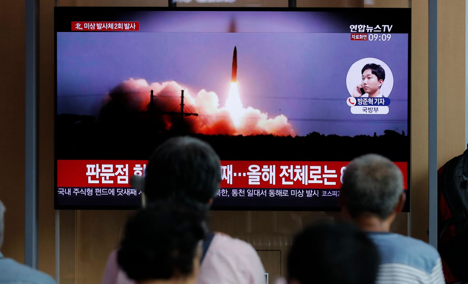 People watch a TV news program reporting about North Korea's firing projectiles with a file image at the Seoul Railway Station in Seoul, South Korea, Friday, Aug. 16, 2019.{ } (AP Photo/Lee Jin-man)