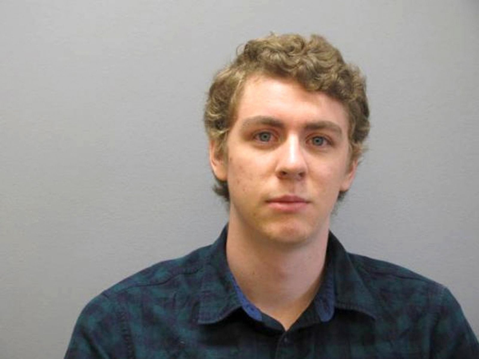 FILE - This Sept. 6, 2016 file photo released by the Greene County Sheriff's Office, shows Brock Turner at the Greene County Sheriff's Office in Xenia, Ohio, where he officially registered as a sex offender. (Greene County Sheriff's Office via AP, File)