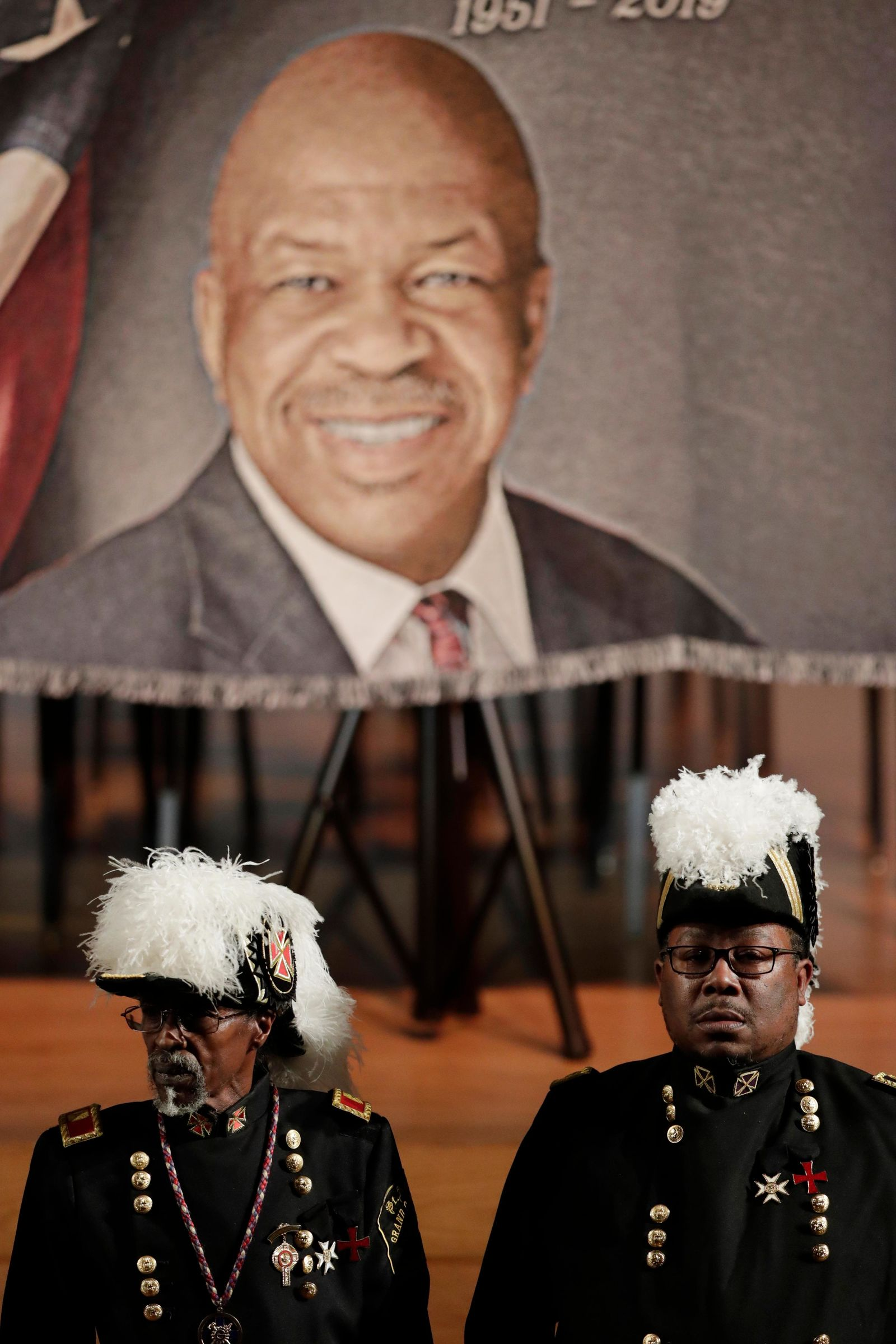 Masonic guards stand in front of an image of the late U.S. Rep. Elijah Cummings during a viewing service at Morgan State University, Wednesday, Oct. 23, 2019, in Baltimore. The Maryland congressman and civil rights champion died Thursday, Oct. 17, at age 68 of complications from long-standing health issues. (AP Photo/Julio Cortez)