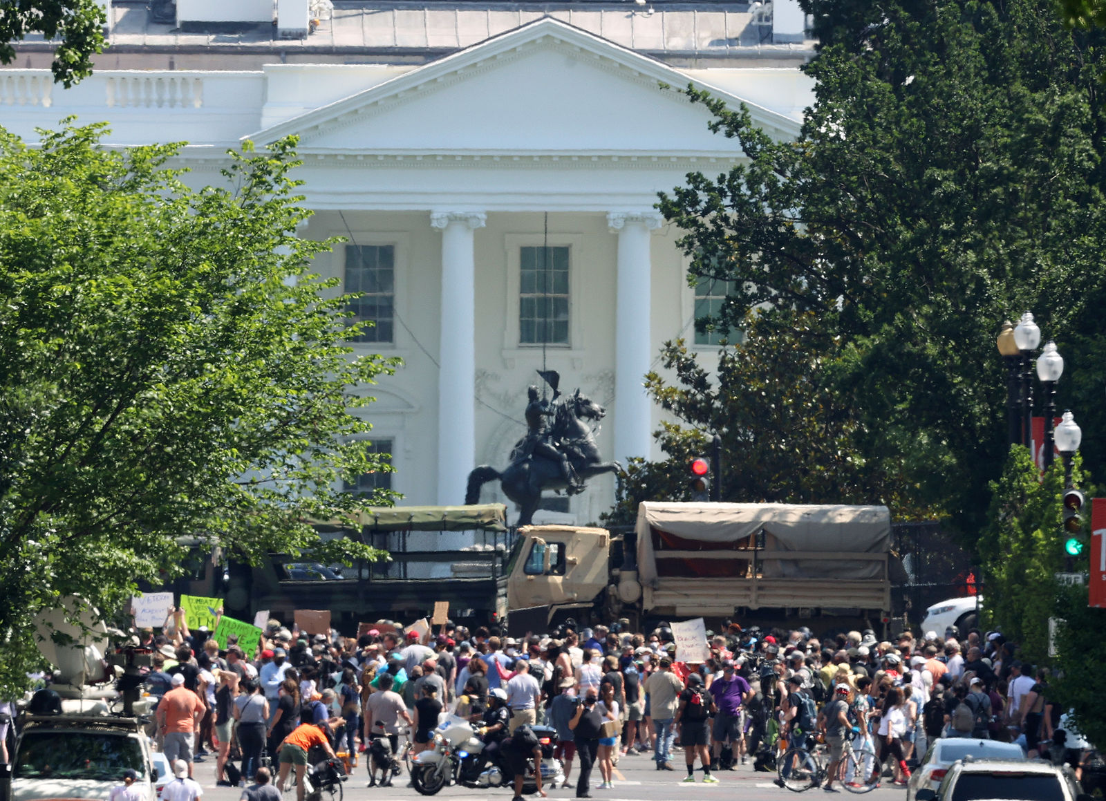 WASHINGTON, DC - JUNE 03: D.C. National Guard vehicles are used to block 16th Street near Lafayette Park and the White House as while people participate in a peaceful protest against police brutality and the death of George Floyd, on June 3, 2020 in Washington, DC. Protests in cities throughout the country have been largely peaceful in the wake of the death of George Floyd, a black man who was killed in police custody in Minneapolis on May 25.  (Photo by Win McNamee/Getty Images)
