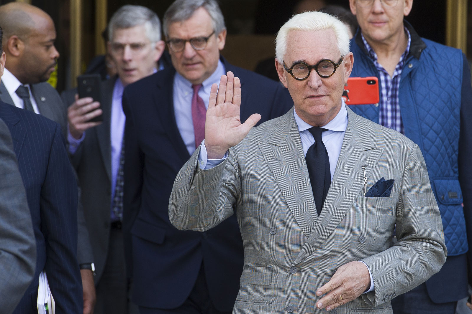 FILE - In this Thursday, March 14, 2019, file photo, Roger Stone, an associate of President Donald Trump, leaves U.S. District Court after a court status conference on his seven charges: one count of obstruction of an official proceeding, five counts of false statements and one count of witness tampering, in Washington. (AP Photo/Cliff Owen, File)