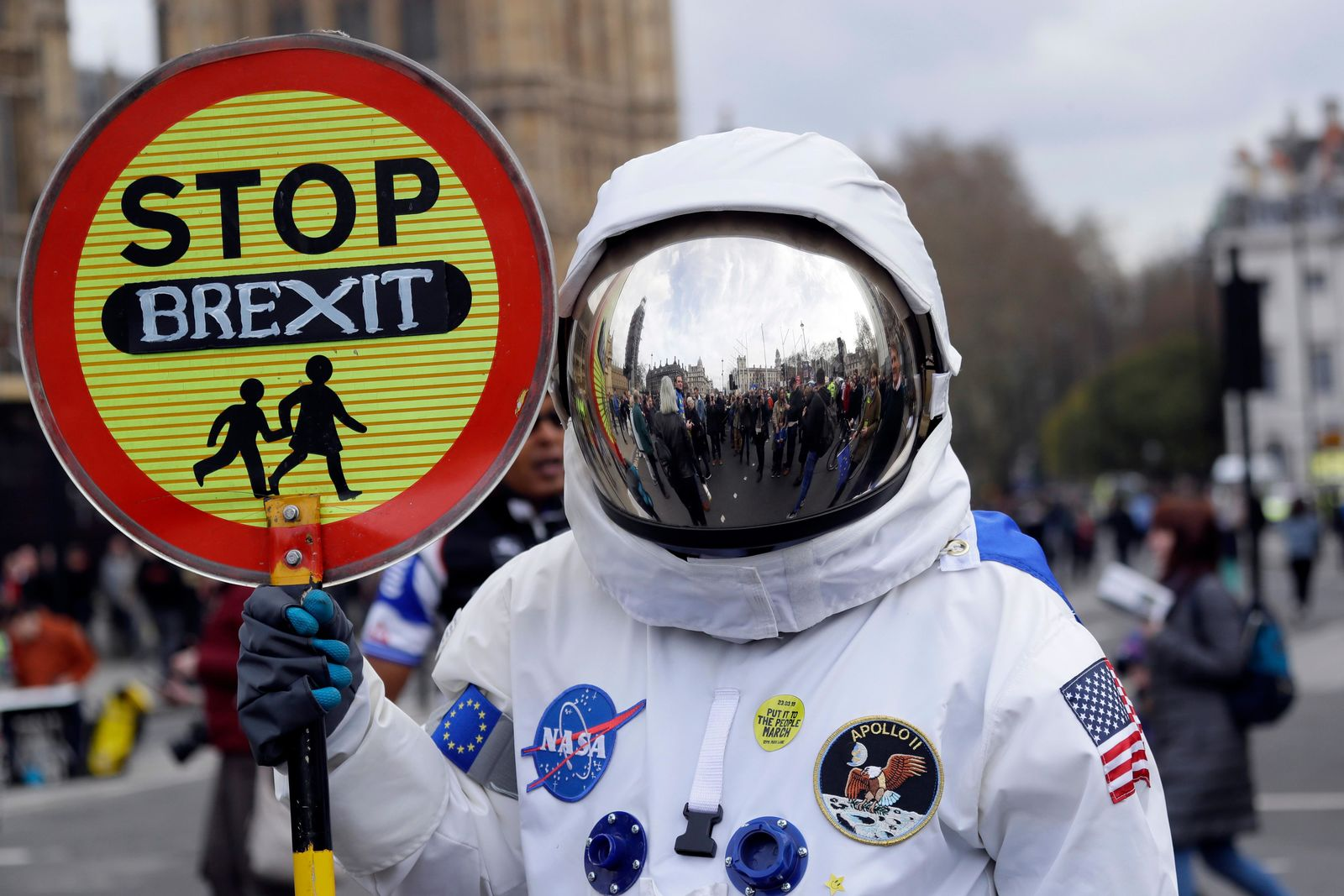 A demonstrator in an astronaut suit carries a sign during a Peoples Vote anti-Brexit march in London, Saturday, March 23, 2019.{ } (AP Photo/Kirsty Wigglesworth)