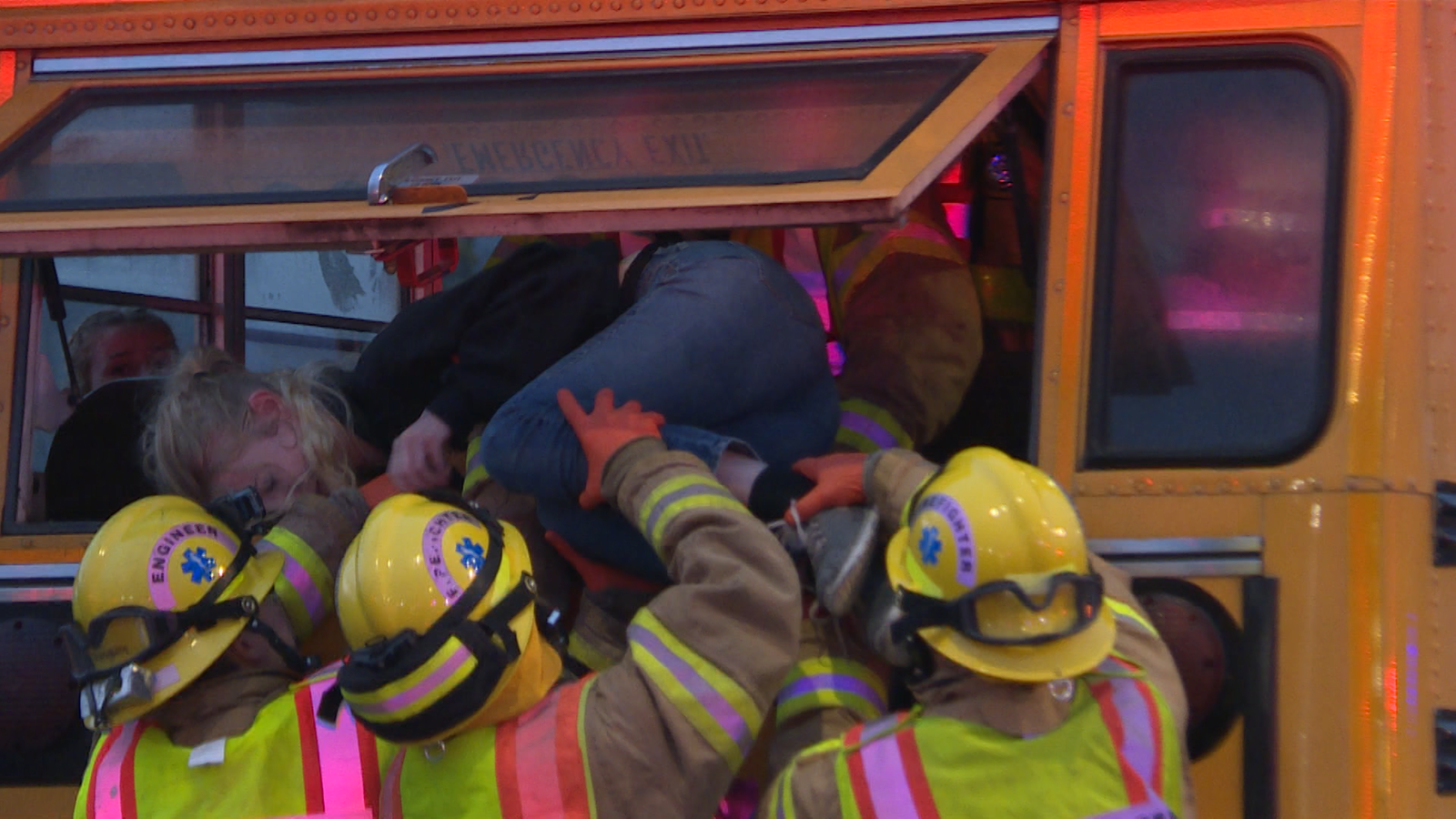Girl being carried out of the bus during an emergency drill (Shelby Reilly/News 10).