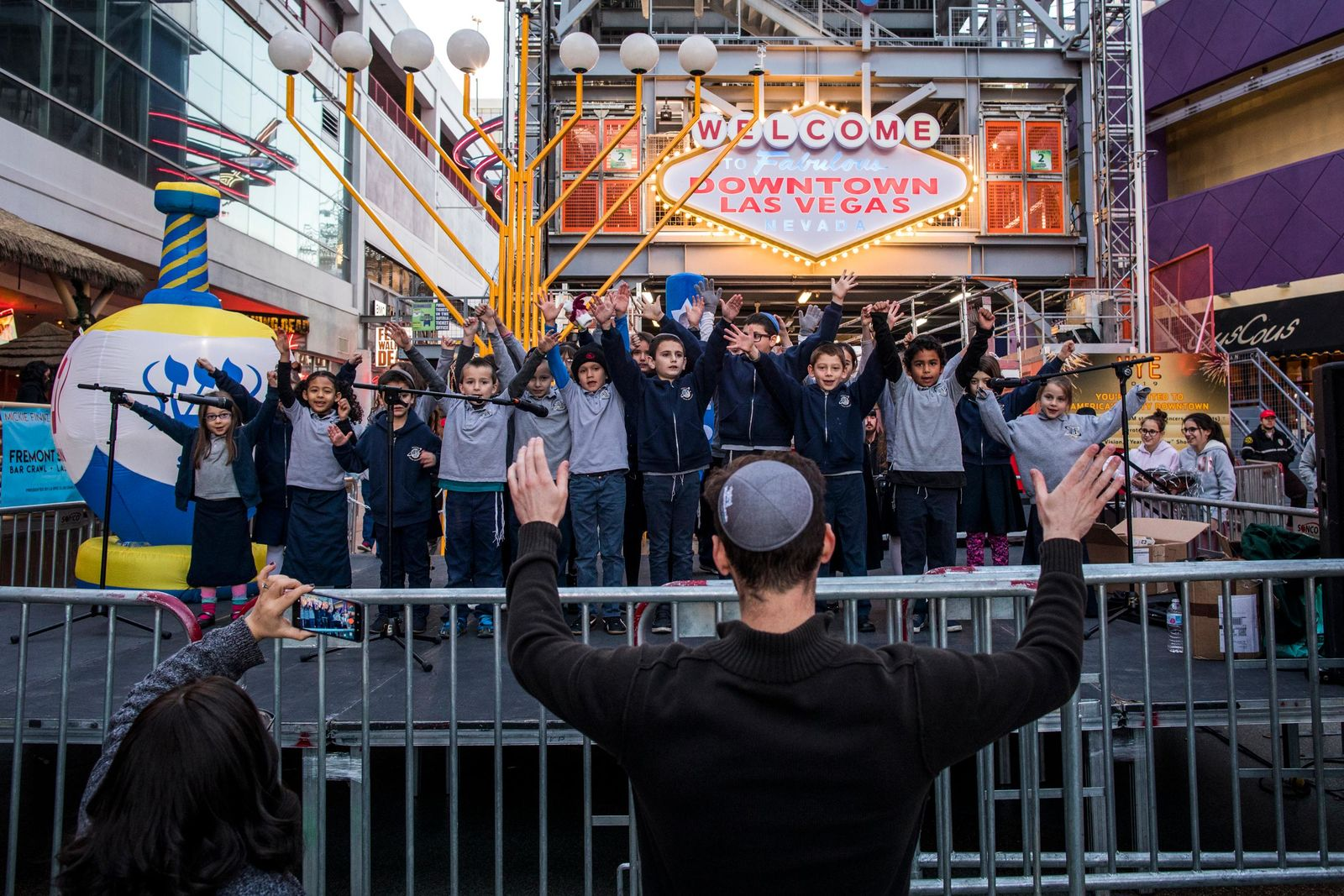 The Desert Torah Academy Children?s Choir sings before the lighting of the Grand Menorah in downtown Las Vegas on Sunday, Dec. 2. The ceremony featured a 20-foot Grand Menorah, with ceremonies led by Rabbi Shea Harlig from Chabad of Southern Nevada. CREDIT: Joe Buglewicz/Las Vegas News Bureau