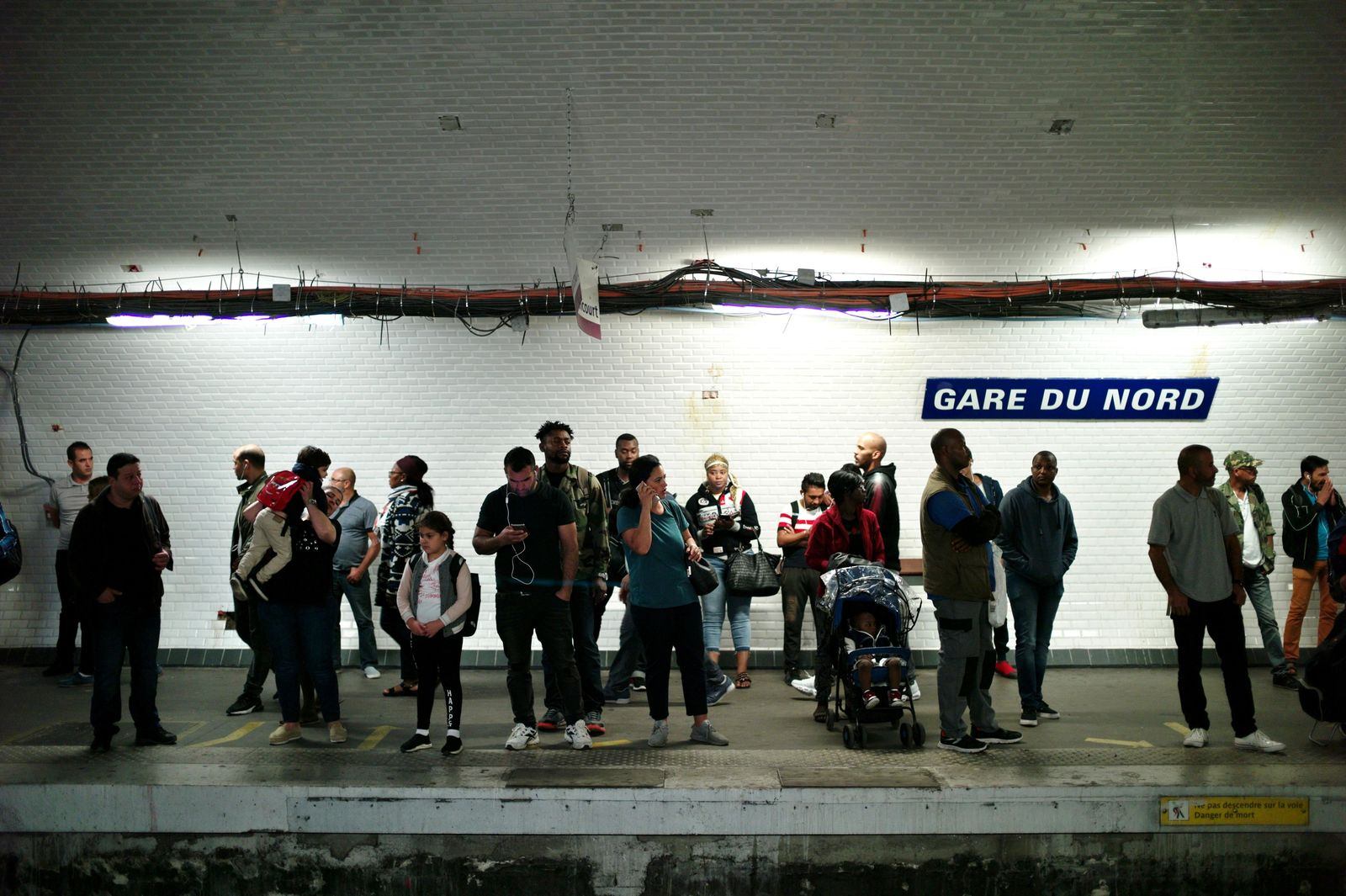 Commuters wait to board a train, in Gare du Nord railway station, in Paris, Friday, Sept. 13, 2019. Paris metro warns over major strike, transport chaos Friday. (AP Photo/Thibault Camus)