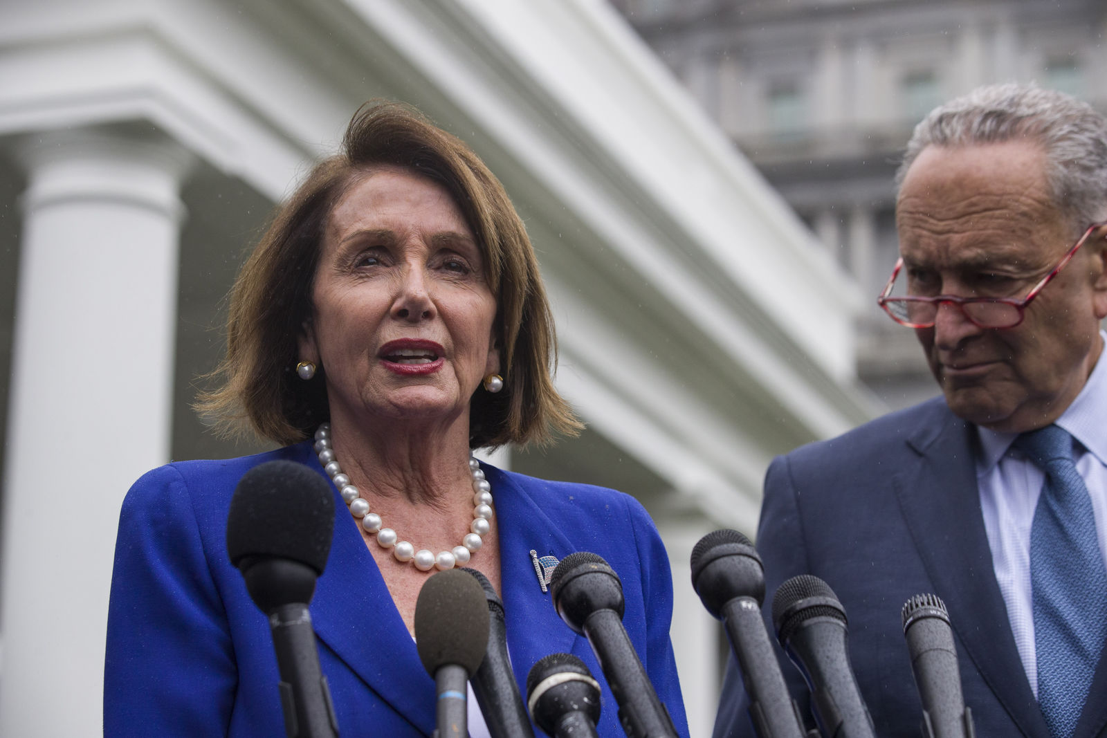 House Speaker Nancy Pelosi of Calif., left, and Senate Minority Leader Chuck Schumer of N.Y., speak with reporters after a meeting with President Donald Trump at the White House, Wednesday, Oct. 16, 2019, in Washington. (AP Photo/Alex Brandon)