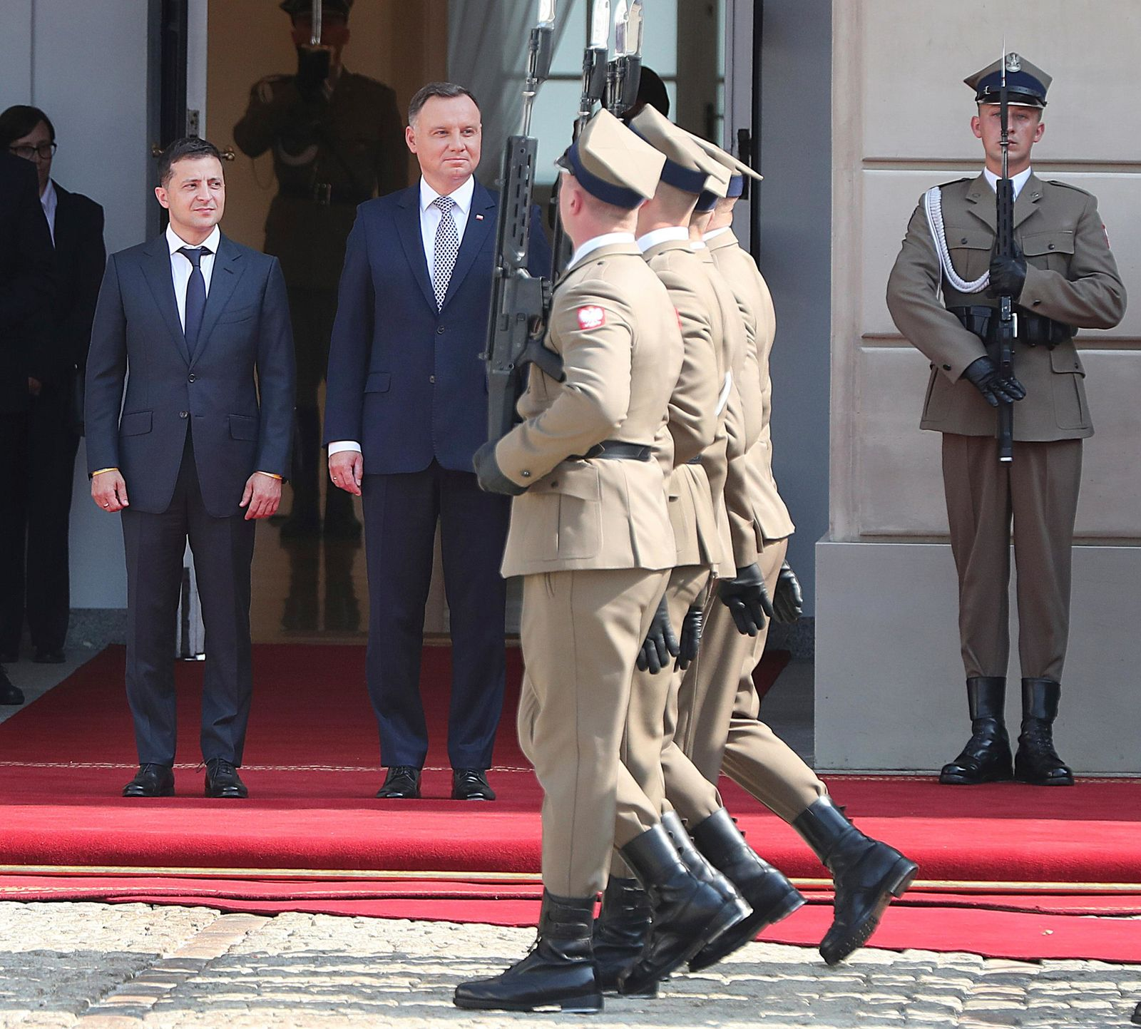Poland's President Andrzej Duda,center, welcomes Ukraine's President Volodymyr Zelenskiy,left, before talks on bilateral relations and Ukraine's ties with Europe under the new government, in front of the Presidential Place in Warsaw, Poland, Saturday, Aug. 31, 2019. .(AP Photo/Czarek Sokolowski)