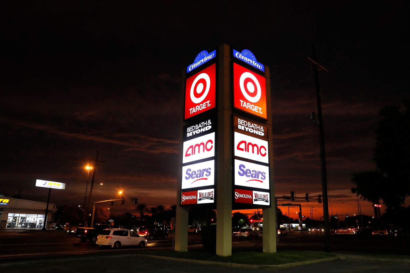 FILE - This Aug. 15, 2019, file photo shows signage for Target, Bed Bath & Beyond, AMC Theaters, and Sears in Metairie, La. Nine months out of bankruptcy, Sears is limping into the holiday shopping season. (AP Photo/Gerald Herbert)